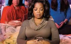 Oprah Winfrey meditates at work