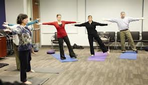 Employees at General Mills do yoga.