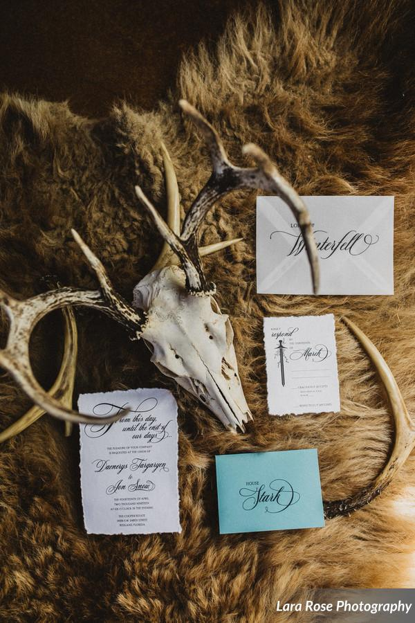 Rustic, hand torn edges wrapped with gray twine sealed with a wax seal. Game of Thrones Wedding invitation by Only One Mark