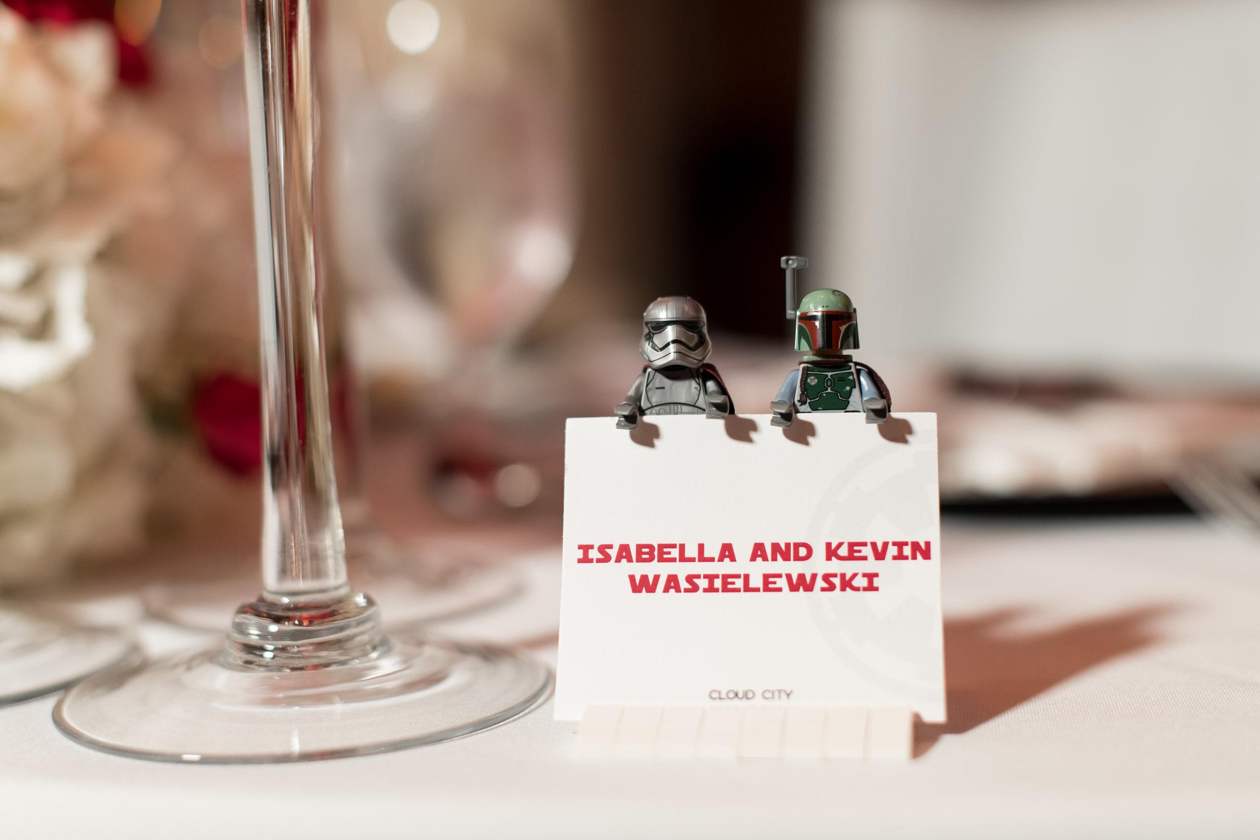 lego Star wars holding wedding  escort cards. Boba Fett and Captain Phasma Lego Figures. Photo shot by  Simply Captivating Photography