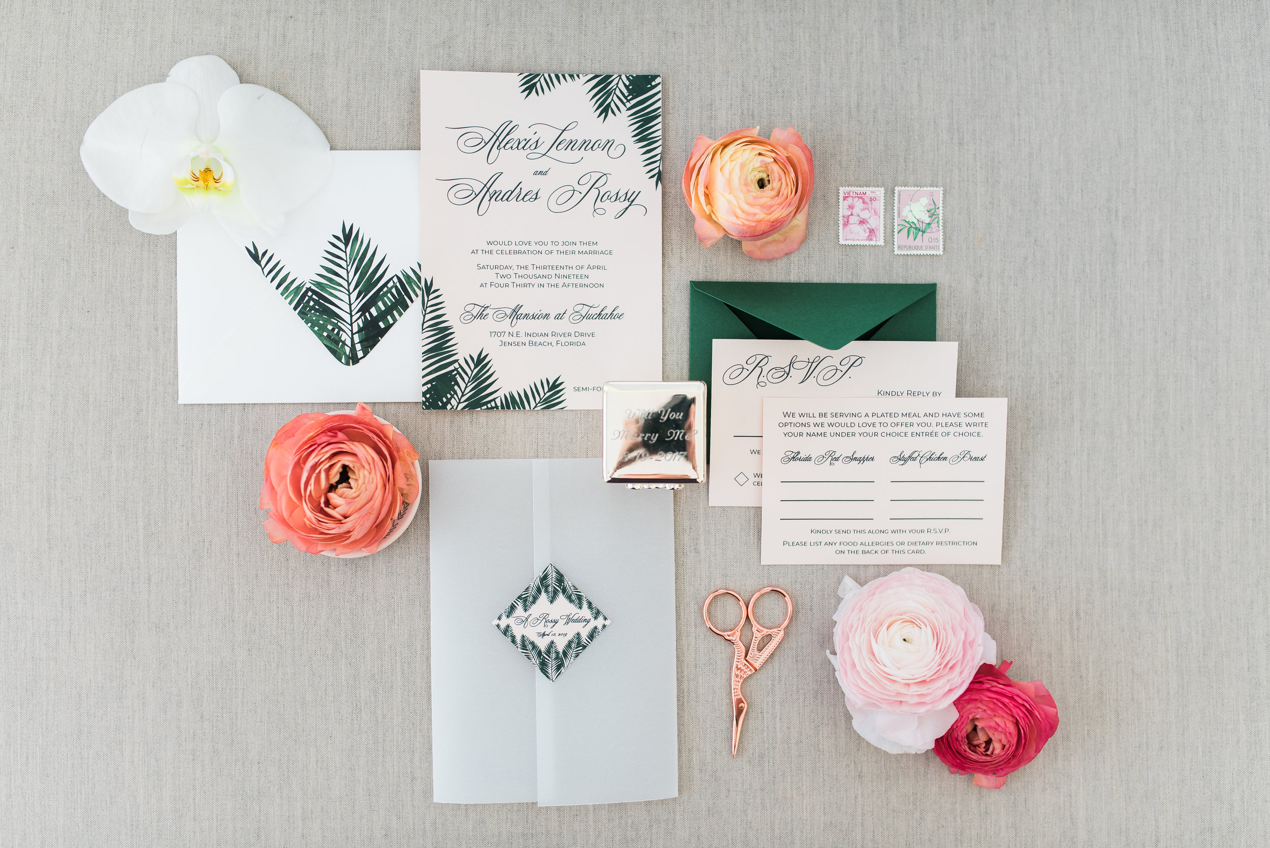 tropical Invitation Suite with palm tree leaf details printed on shimmer blush stock. vellum gatefold with wedding info icon on the front. Double RSVP with Forest Green envelope. Photo shot by  Aurora Photography
