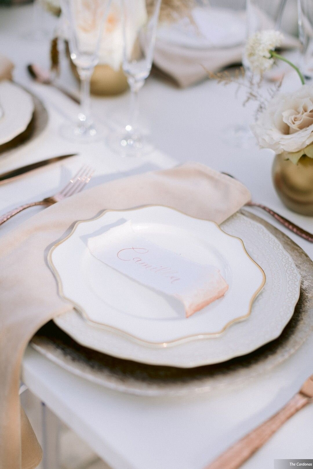 Reception with Rectangular Place Cards on Rose Gold Place Settings. Modern Calligraphy written names in Rose Gold Ink. Made with white handmade paper with a deckled edge or torn paper detail. Watercolor wash on one edge.