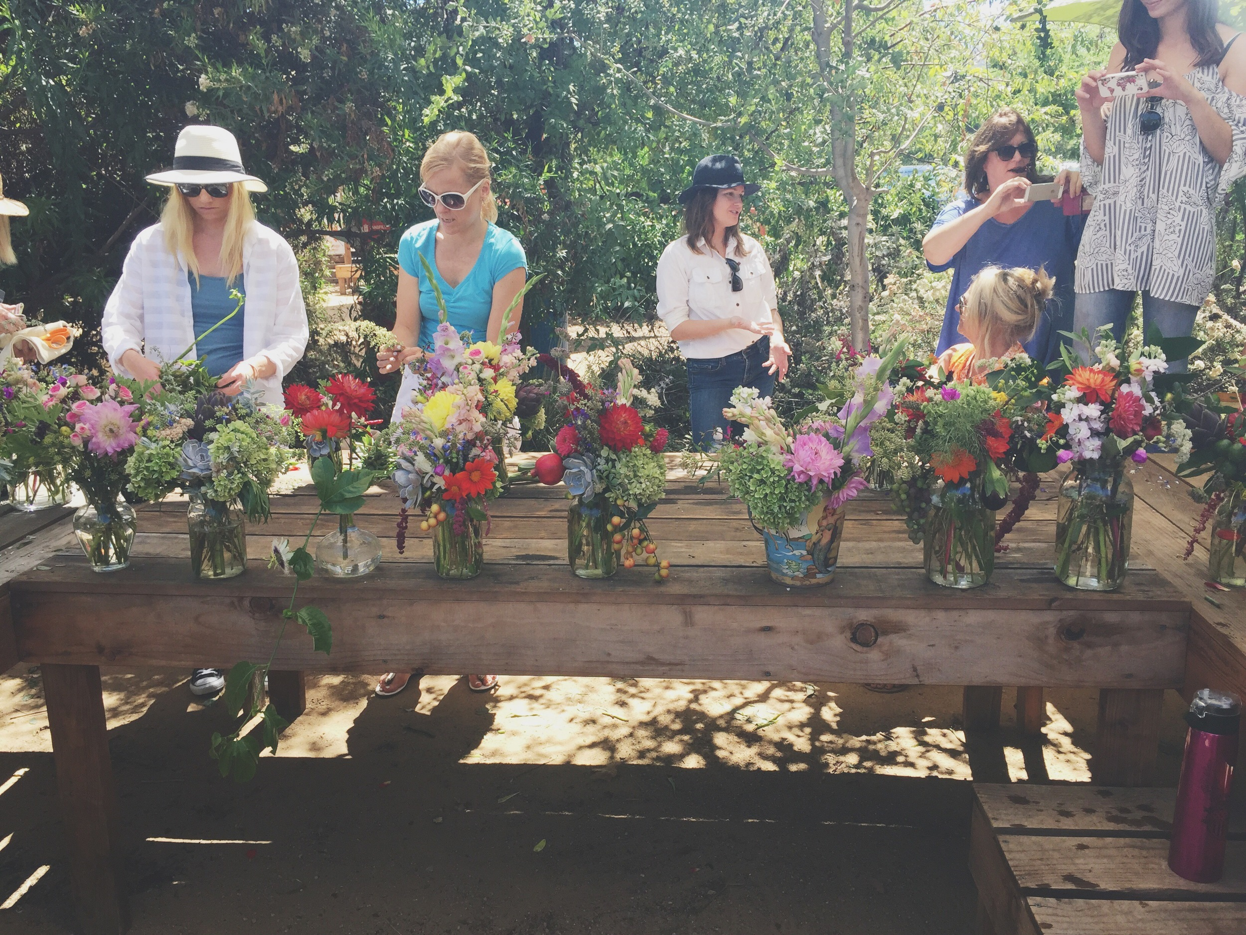 Christa Rose Floralites admiring their beautiful arrangements at the end of class.