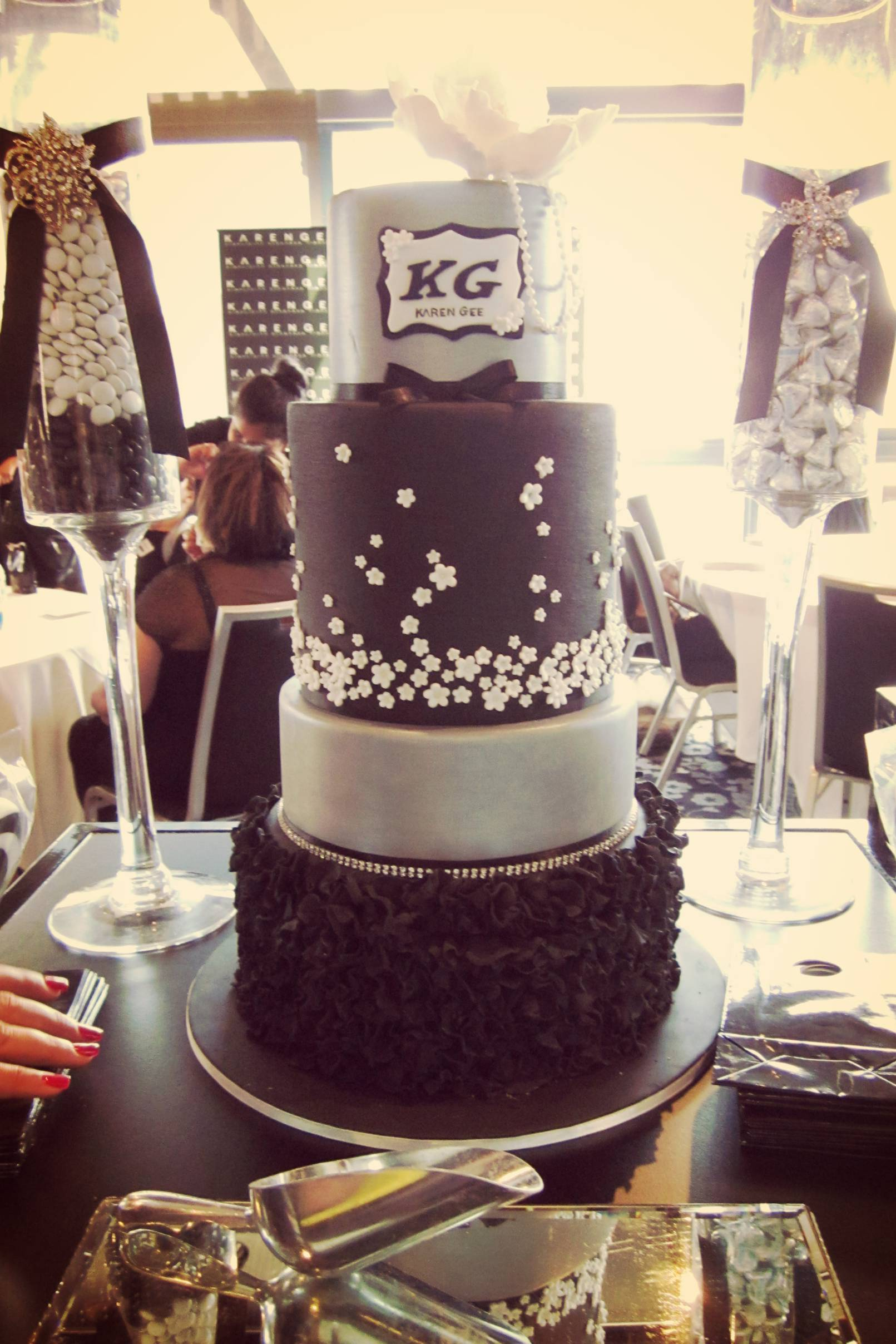 Four-tiered cake by  Miss Shell's Cakes .