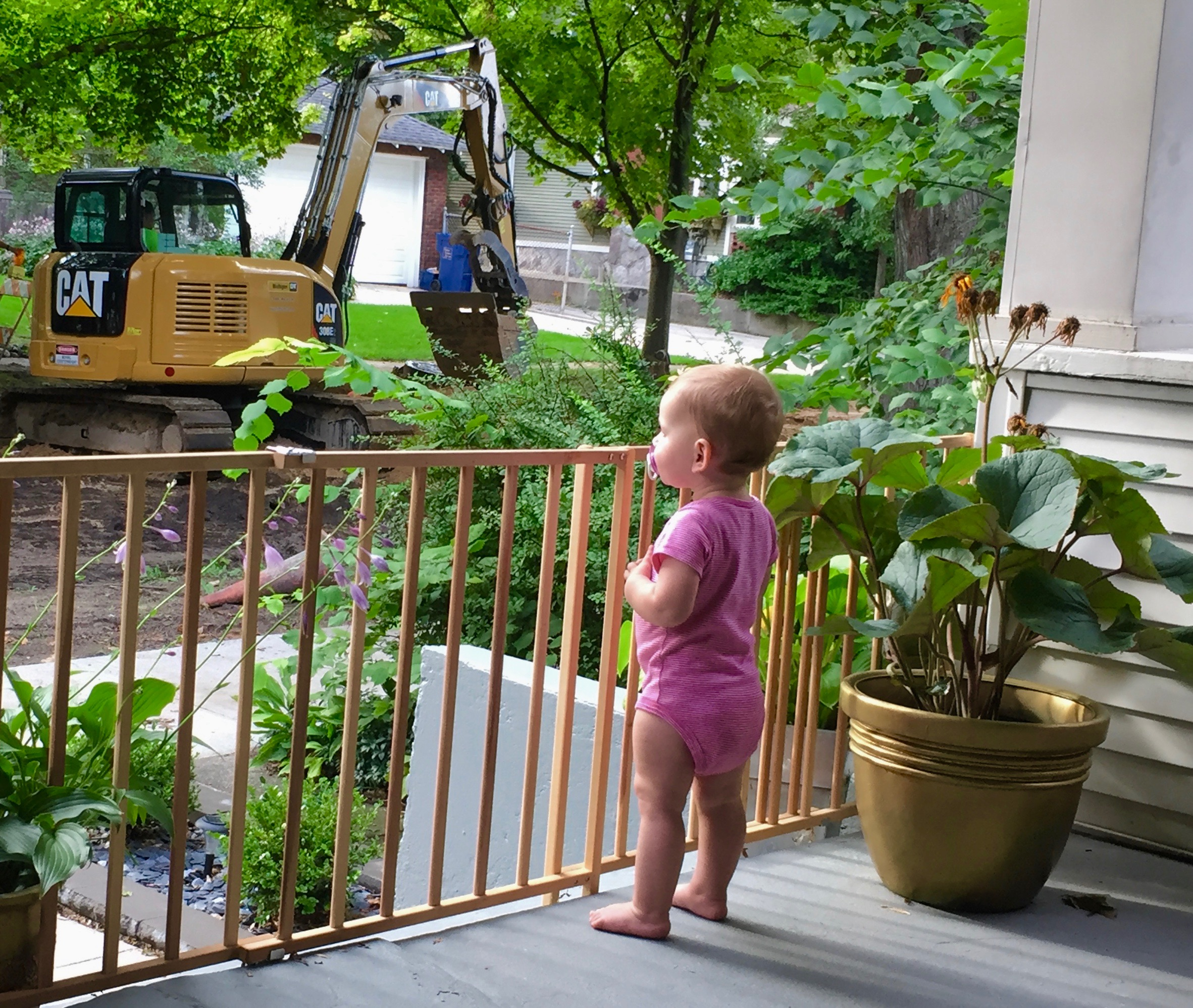 Natalie is loving the commotion on our street much more than Jeff and I are.