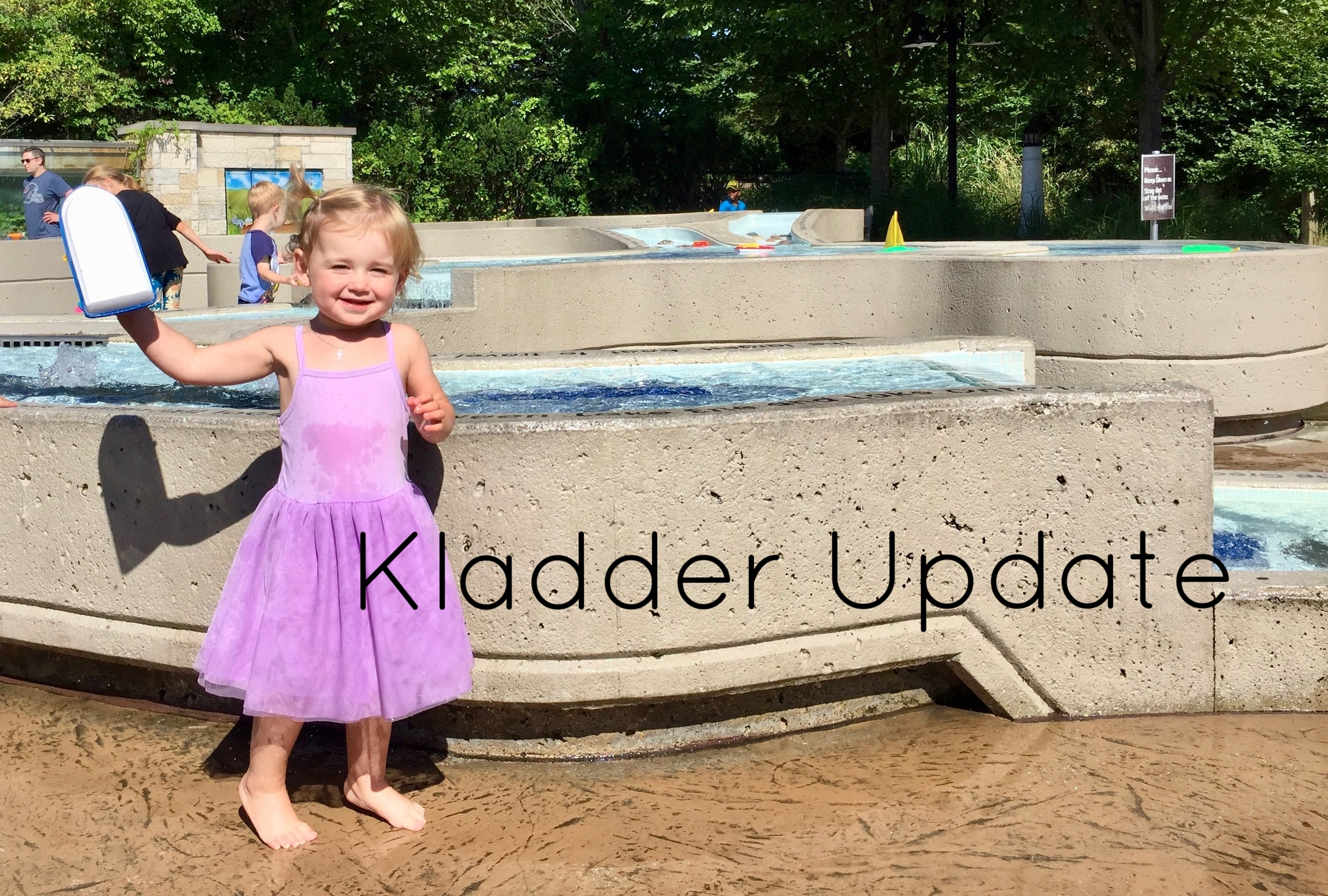 Natalie enjoying the Great Lakes Garden (water pools) at the Lena Meijer Children's Garden.