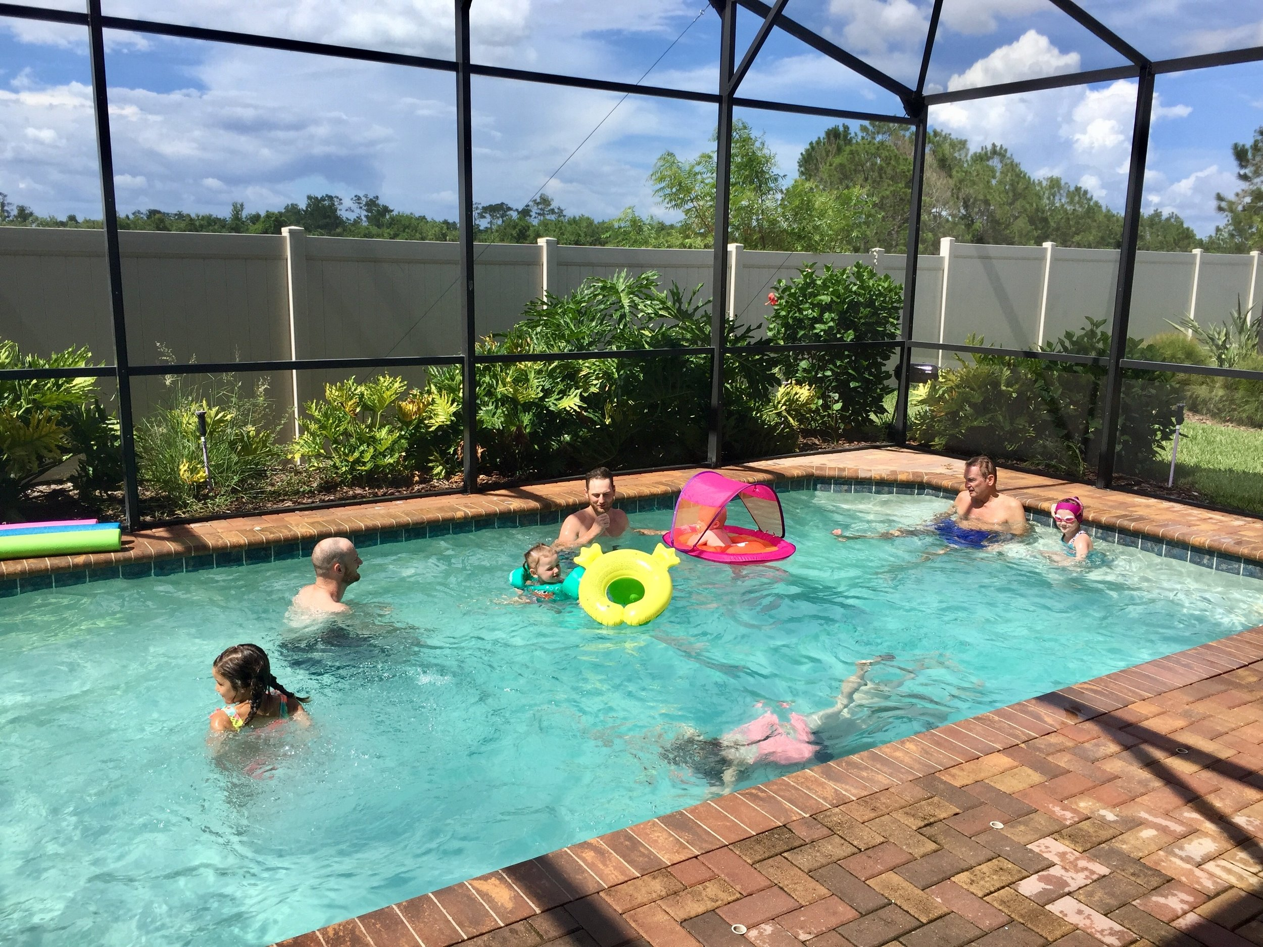 Disney airbnb pool group pic.jpg