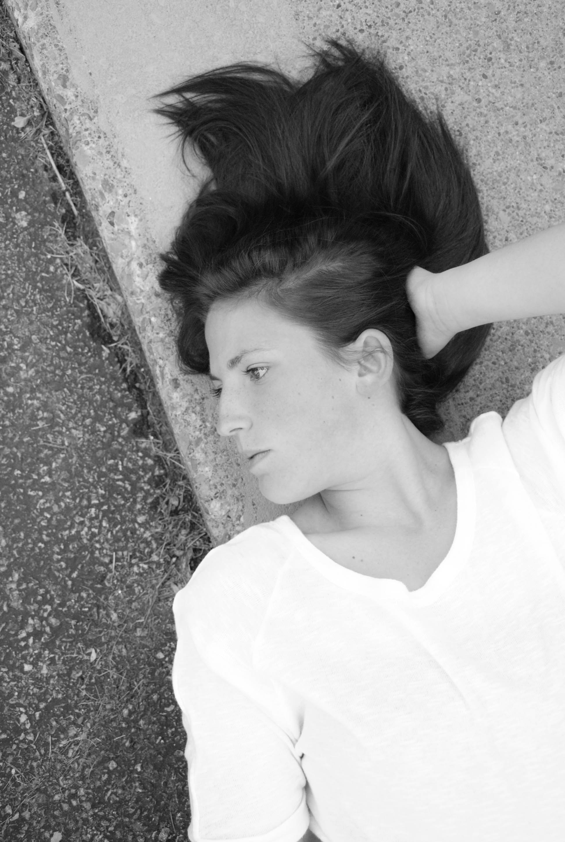 The texture of the pavement and the line of her face…..