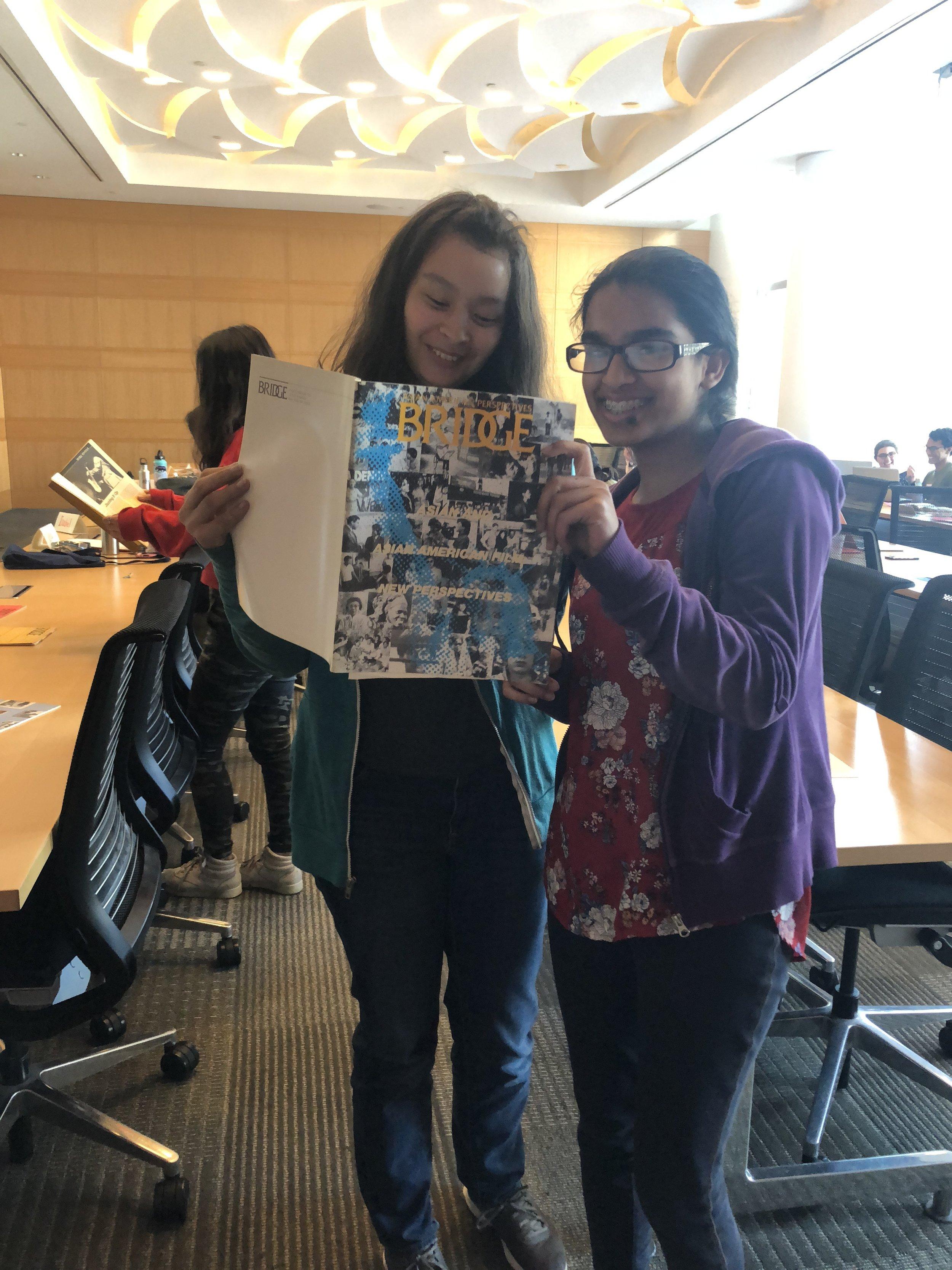 Simi with Chloe Chupungco (left), reading through  Bridge  magazine!
