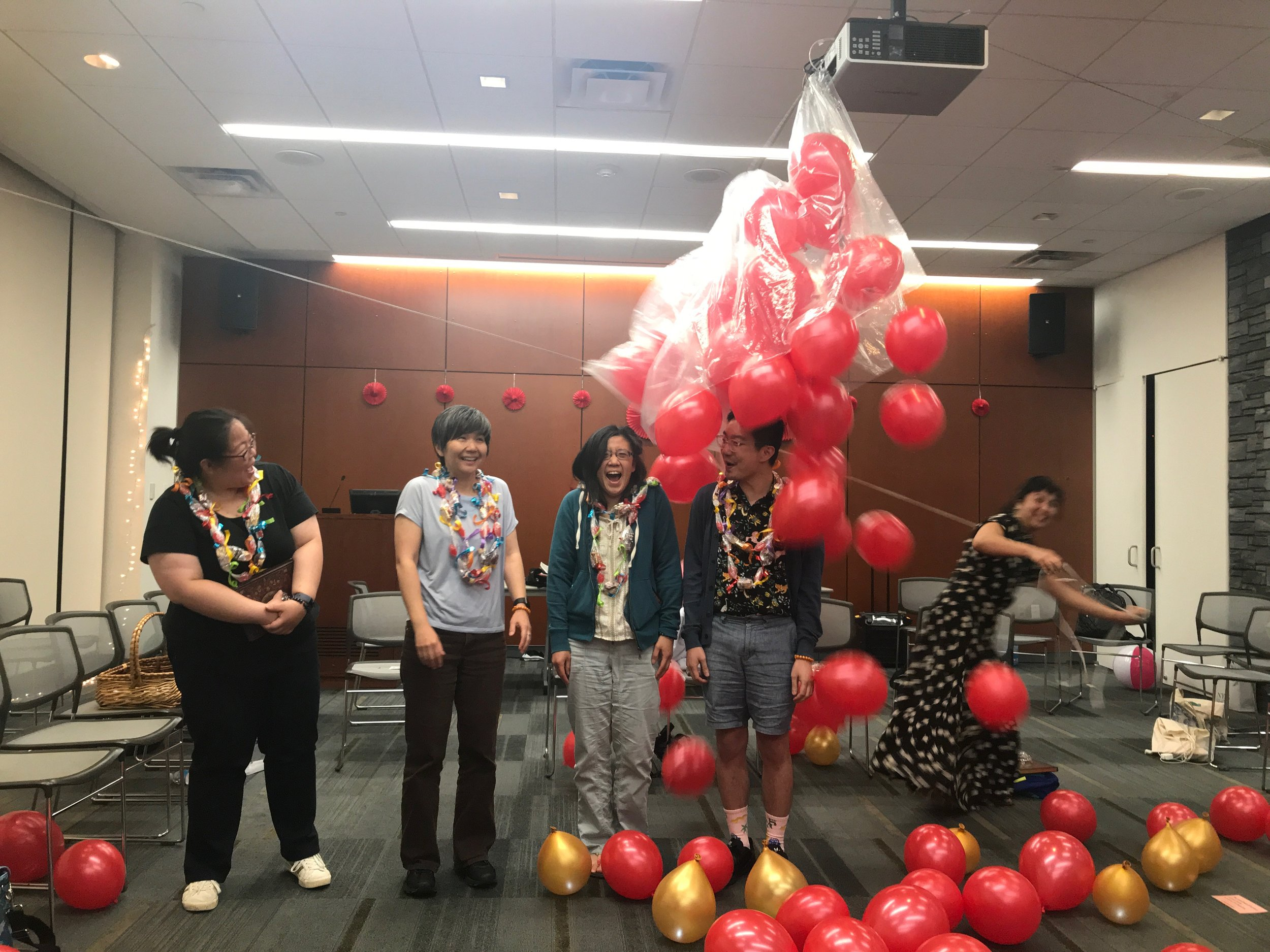 Graduating Fellows Diana Park, Heather Nagami, Jane Lin, and Chen Chen during the balloon drop!