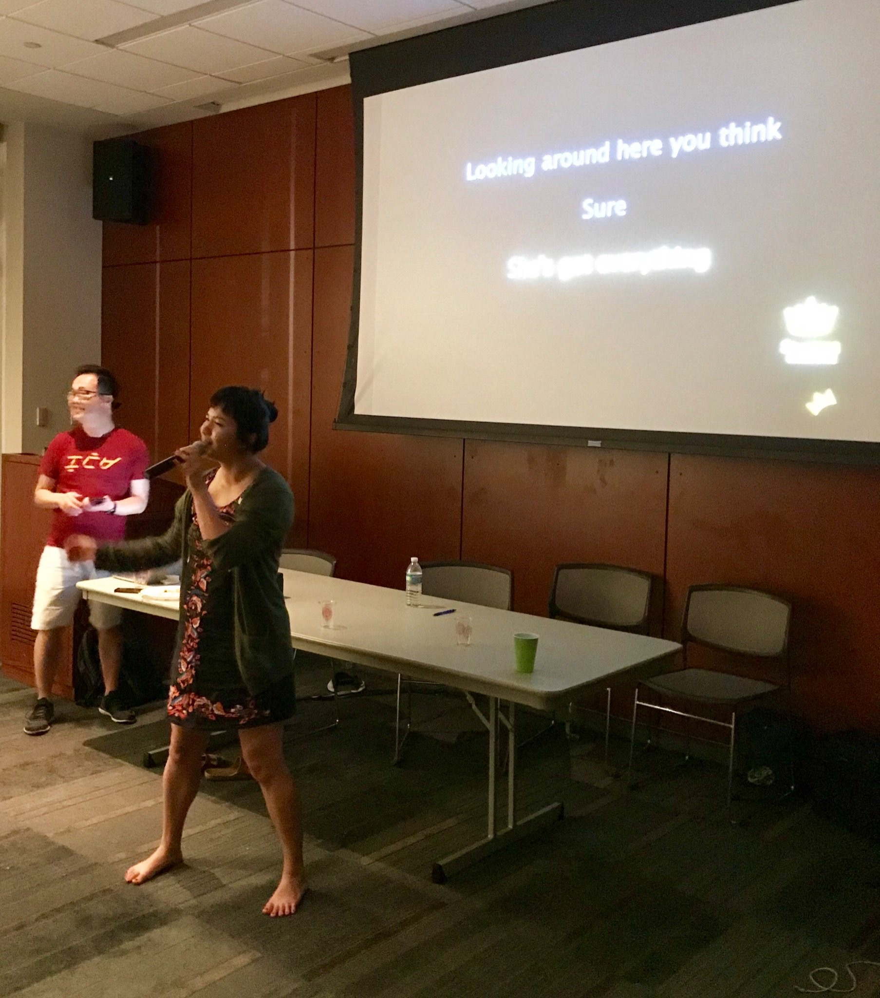 """Executive Director Cathy Linh Che adopts a power stance and sings all of """"Part of Your World"""" from memory!"""