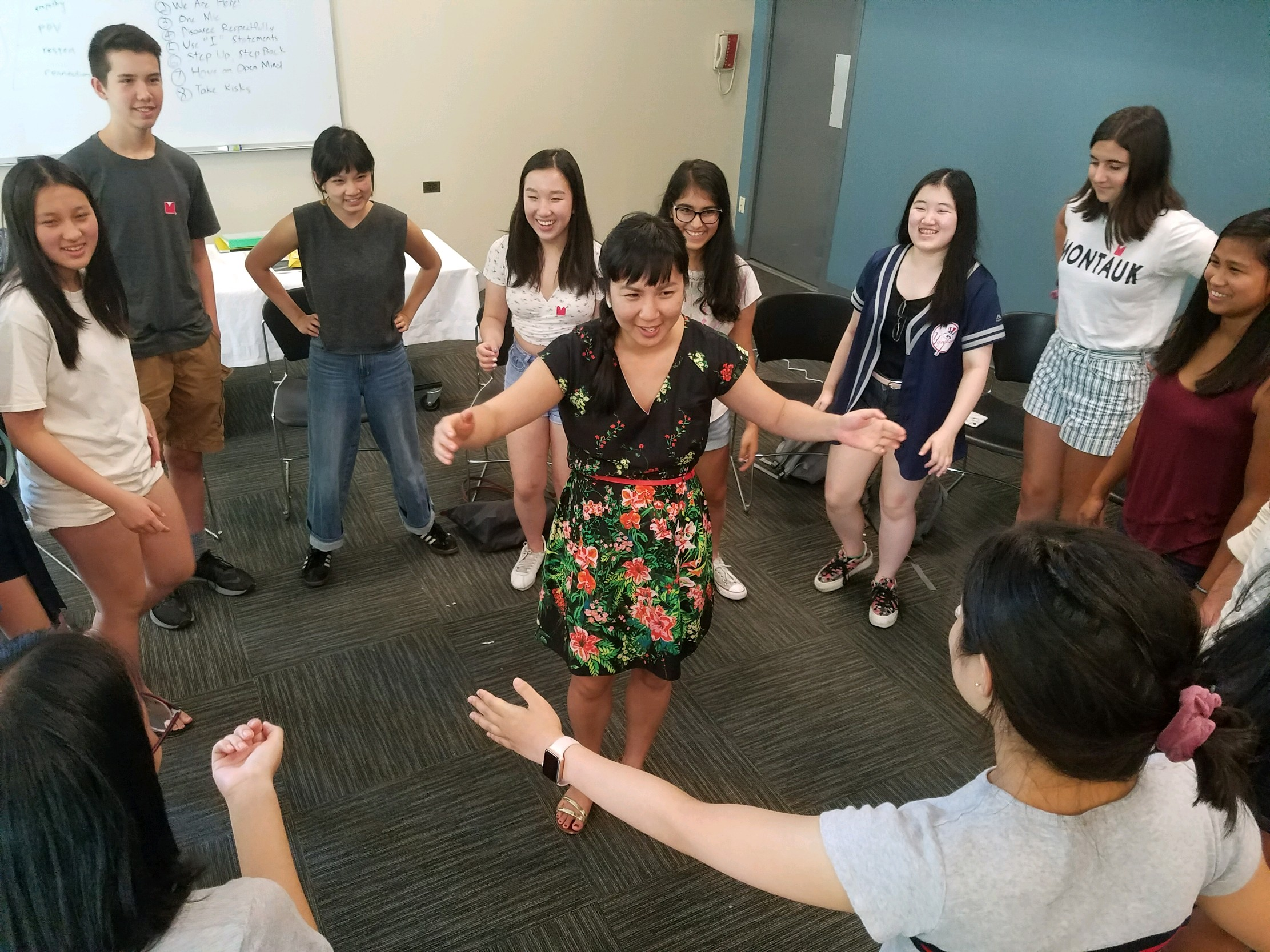 Executive Director Cathy Linh Che gathers everyone for a final group hug!