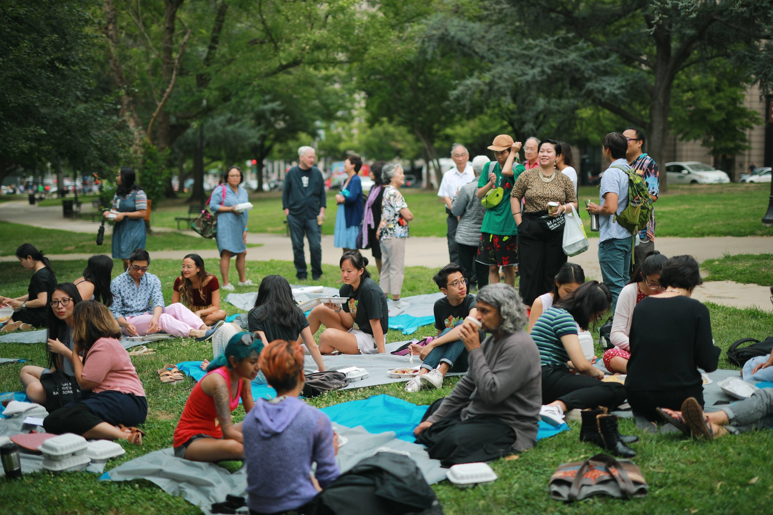 Festival attendees share a meal at the Poet's Peace Breakfast in Franklin Square Park! Photo Credit: Hannah Colen.