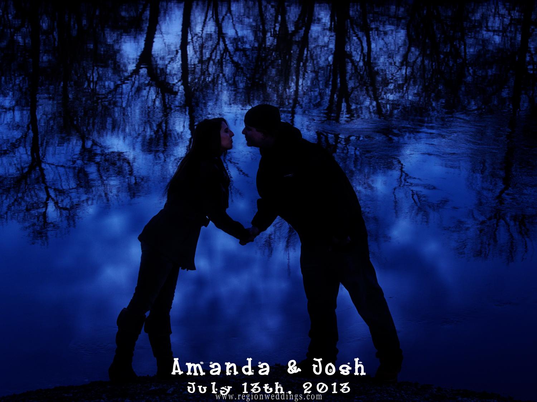Romantic engagement photo taken in silhouette near a frozen lake in a blue mist.