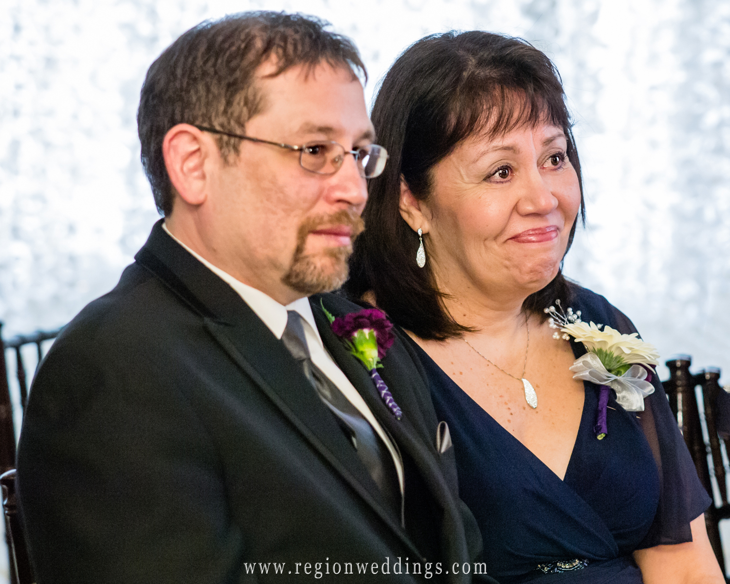 Parents of the bride get emotional in this candid wedding ceremony photo from Northwest Indiana wedding photographer Steve Vansak.