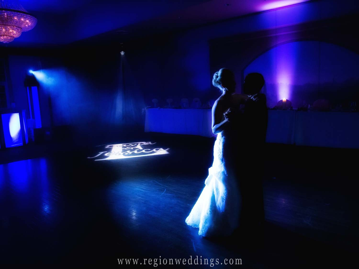 A couple dances alone in the dark at Avalon Manor in Hobart, Indiana for their Fall wedding reception.