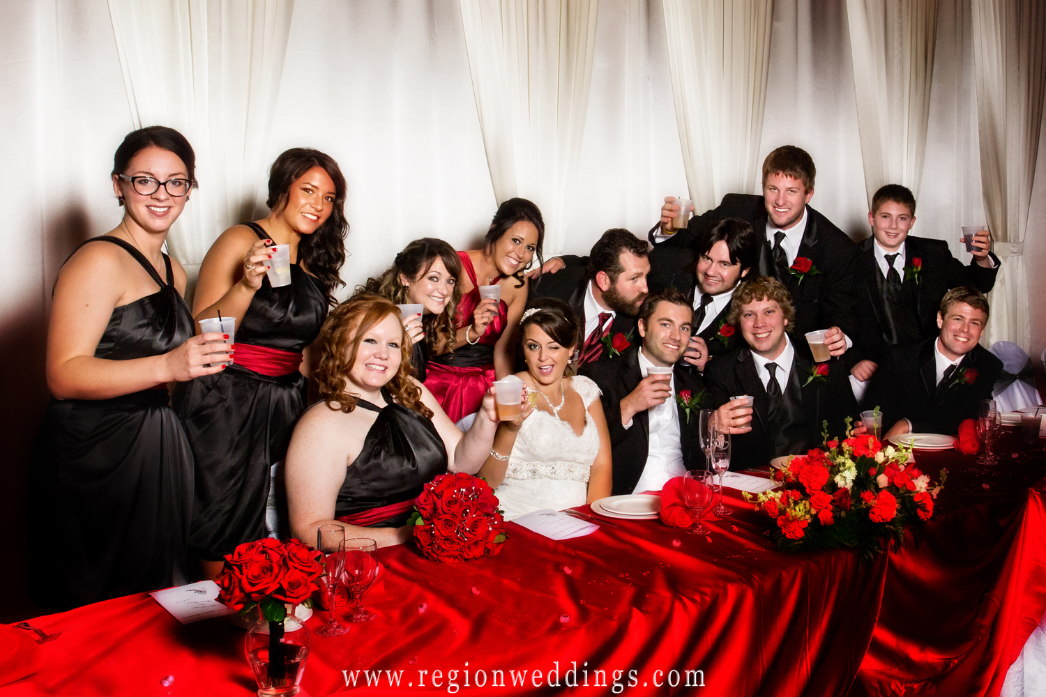 The wedding party hams in up in this fun wedding photo taken at The Halls of St. George in Schererville, Indiana.