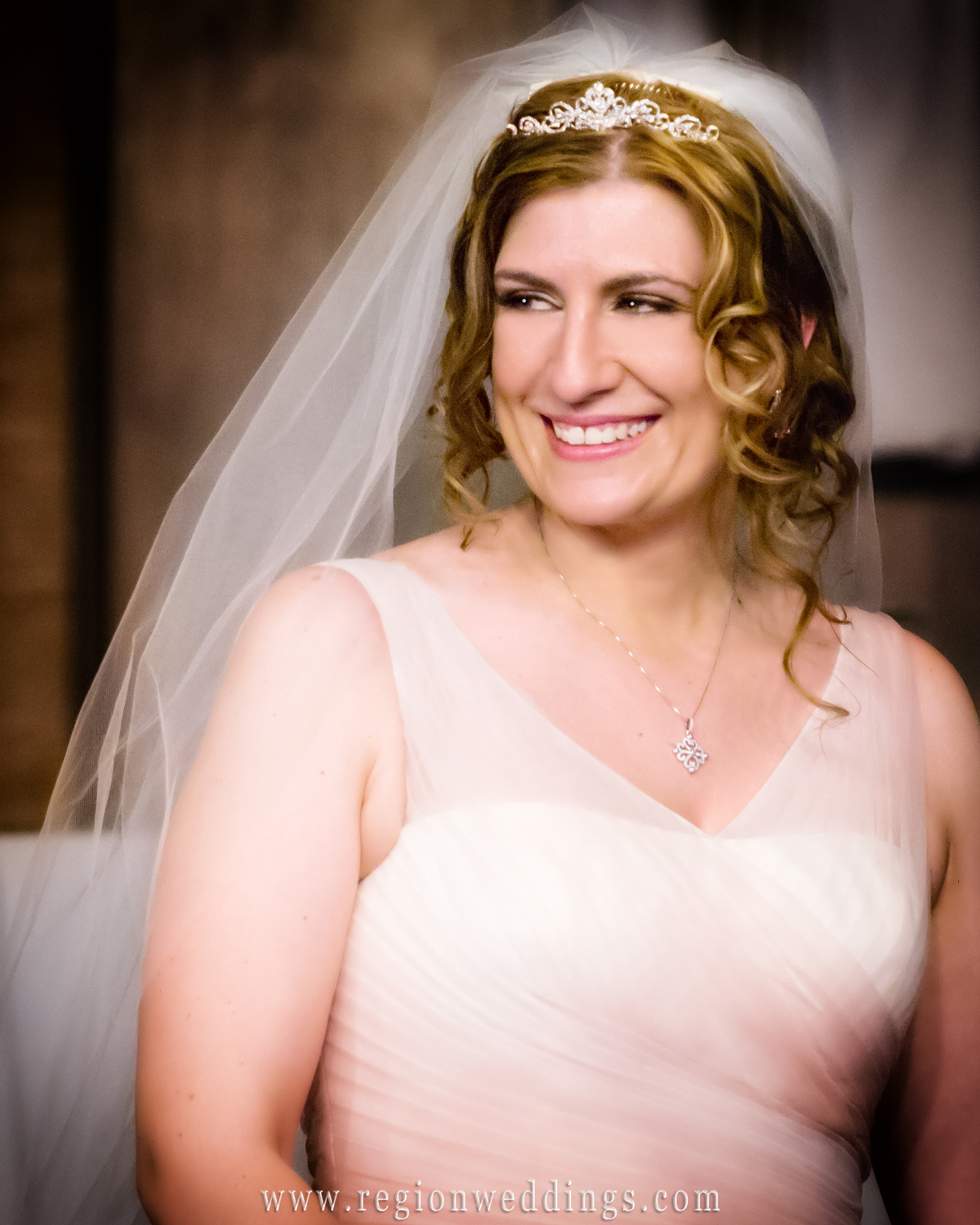 Smiling bride during her Spring wedding at Free Spirit Church in Crown Point, Indiana.