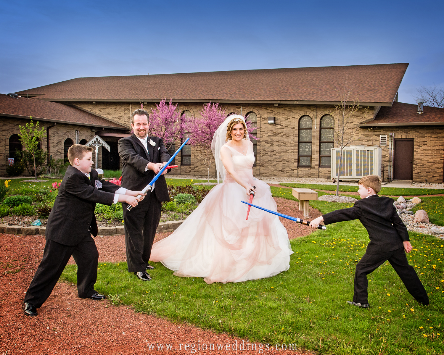 Star Wars themed wedding photo with family showing off their light sabers.