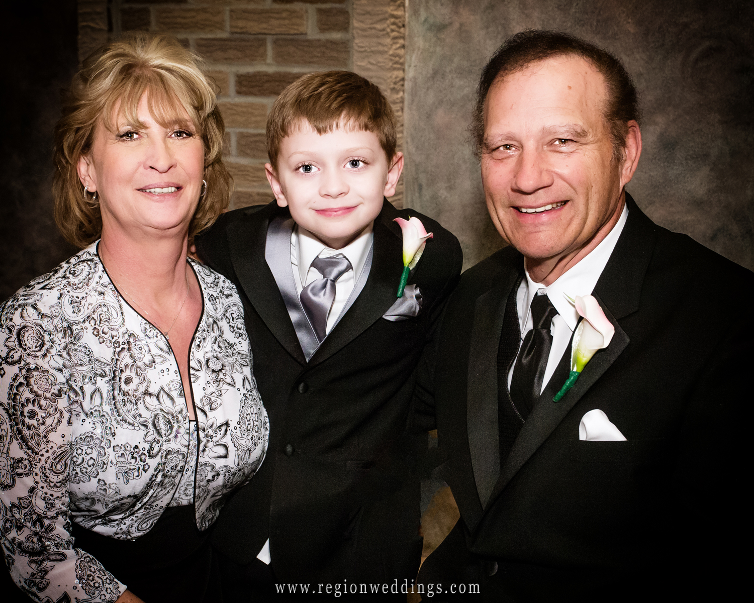 Grandparents with their grandson the ring bearer at a wedding reception at Casa Maria in Dyer, Indiana.