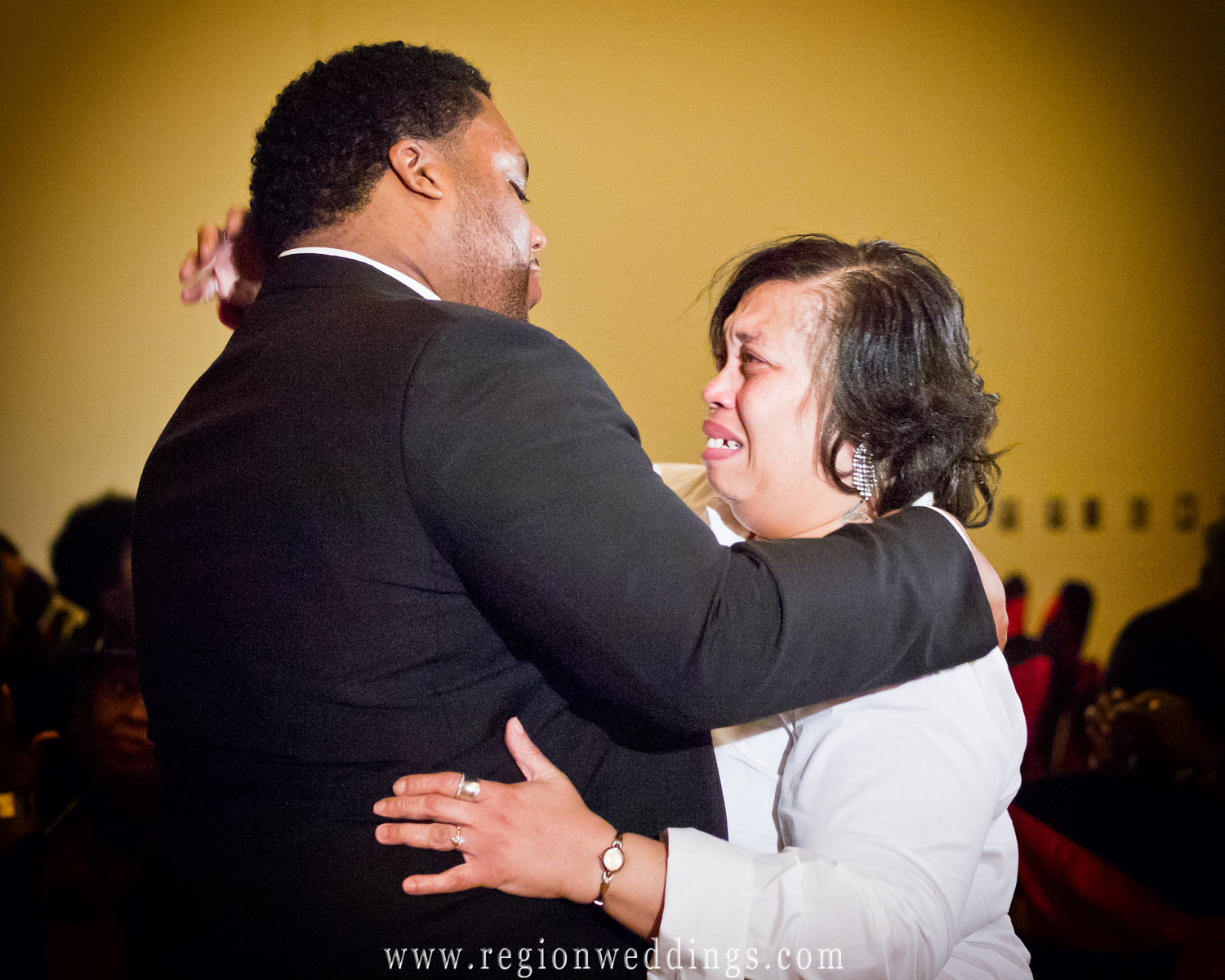 A mom gets emotional during her mother son dance at the Centennial Park clubhouse in Munster, Indiana.