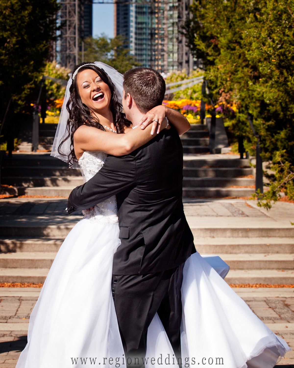 The newly married couple celebrates after becoming man and wife at an outdoor wedding in downtown Chicago.