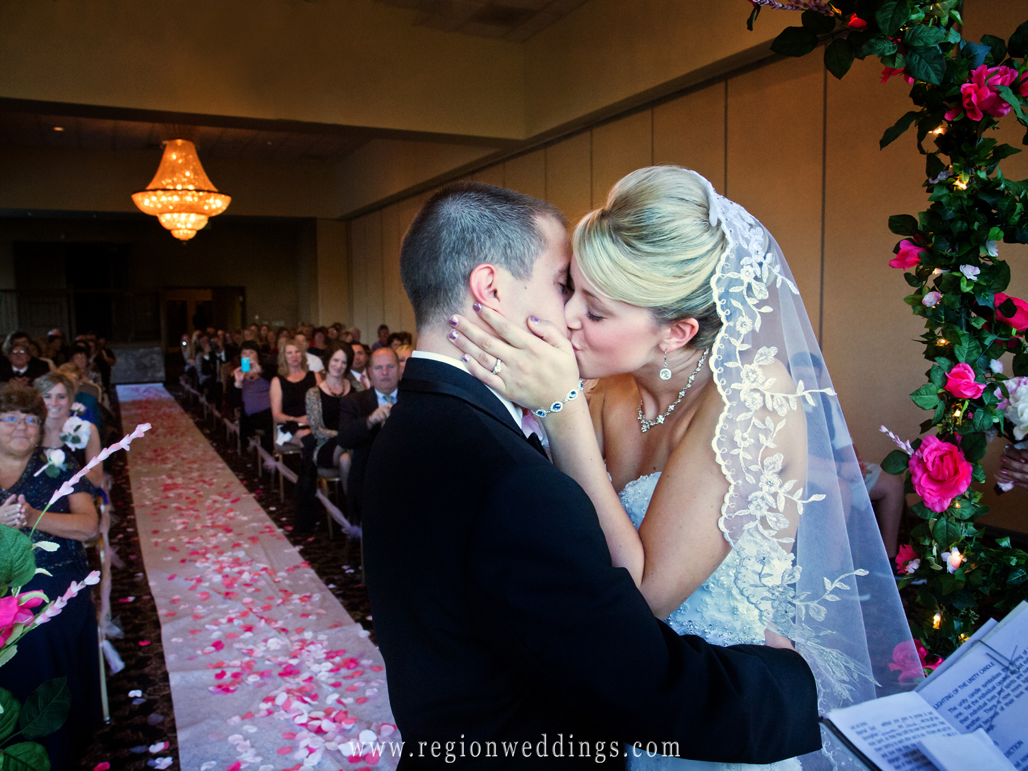 First kiss at an indoor wedding ceremony at Avalon Manor in Hobart, Indiana.