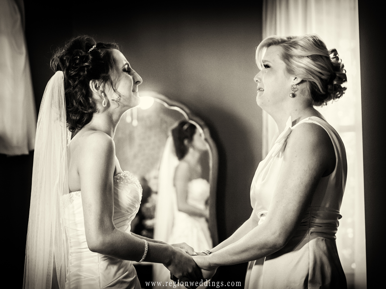 The maid of honor tears up as her best friend gets into her wedding dress on the morning of her June wedding.