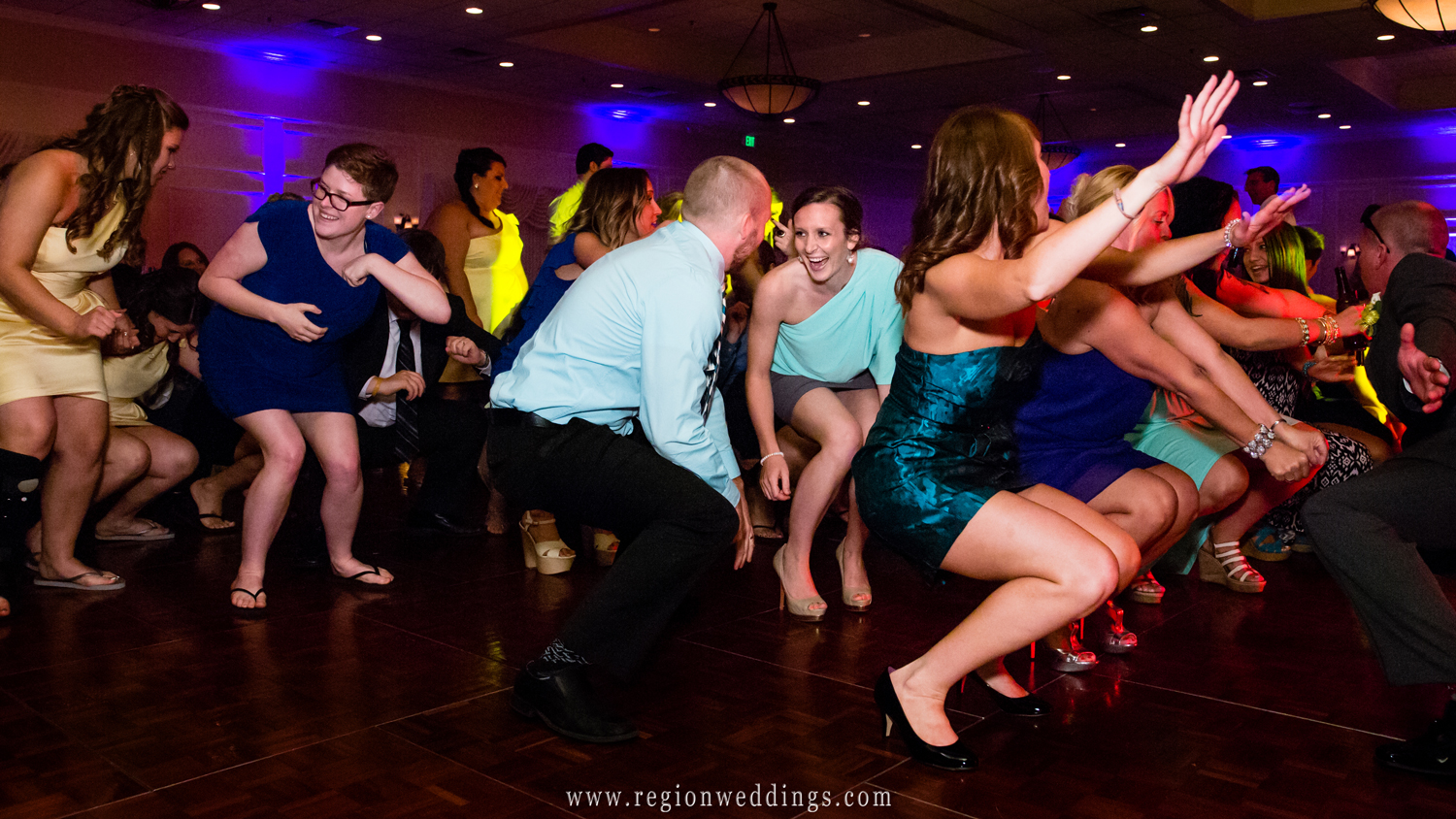 The dance floor at the Banquets of St. George is filled to capacity at a summer wedding reception in Schererville, Indiana.