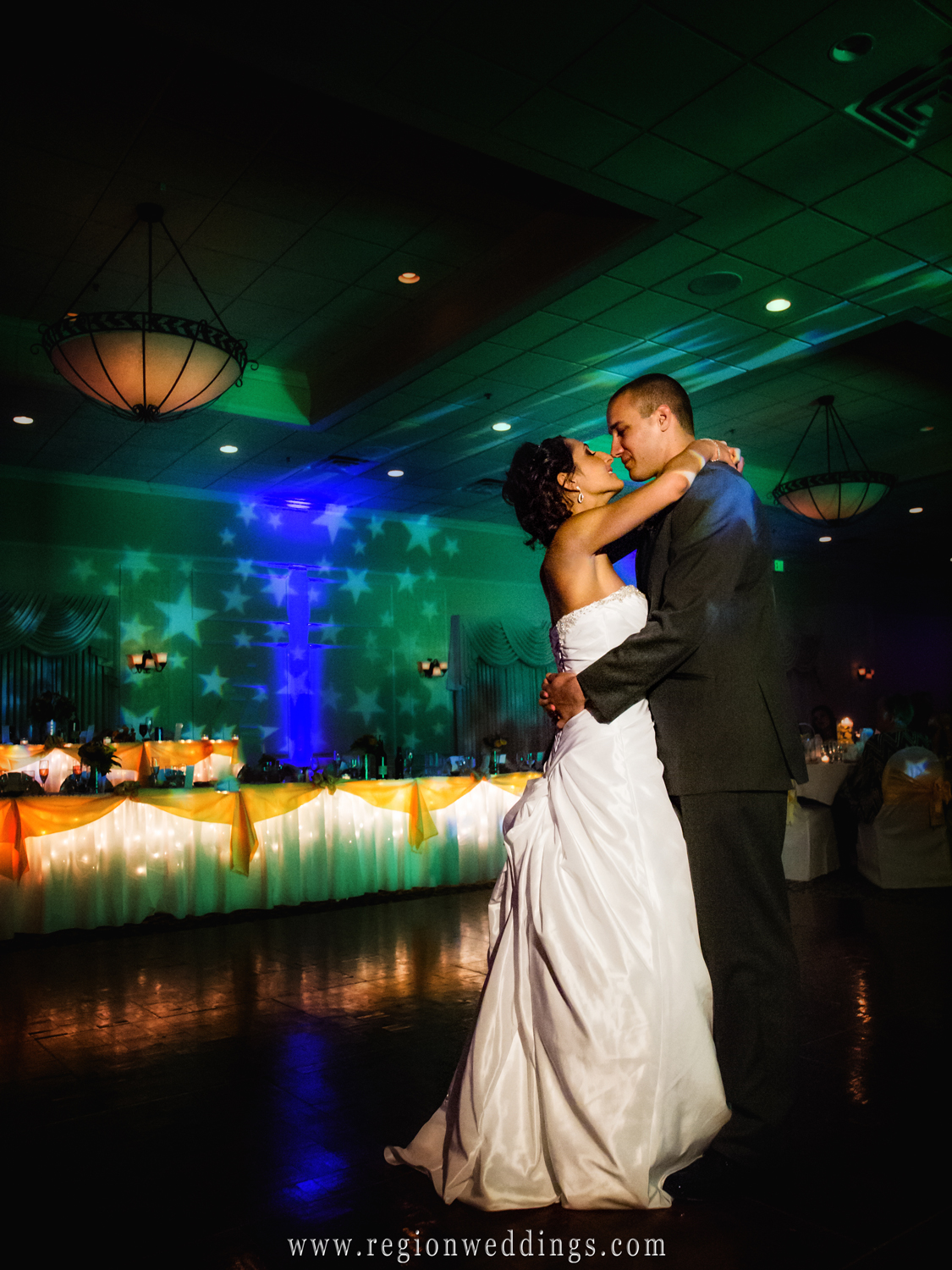 The bride and groom take their first dance at the Banquets of St. George in Schererville, Indiana during their wedding reception.