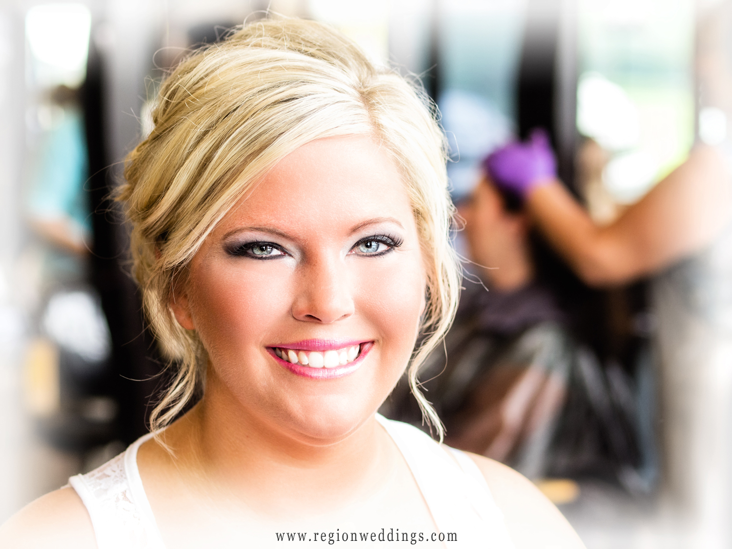 Beautiful window light falls upon the bride as she gets ready for her summer wedding in Crown Point.