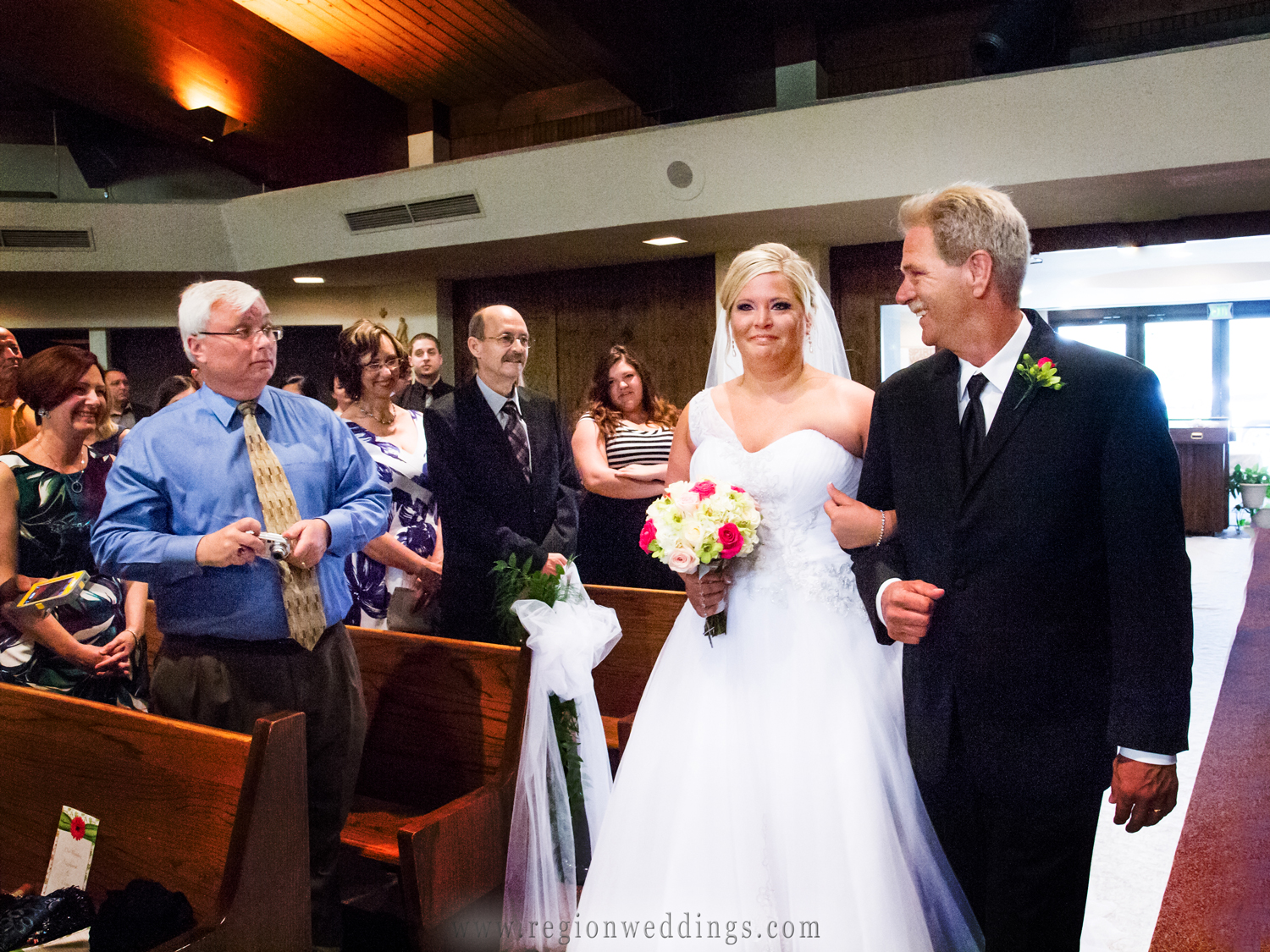 Tears of joy stream down the bride's face as she walks down the aisle with her Dad at St. Elizabeth Ann Seton Church in Valparaiso, Indiana.
