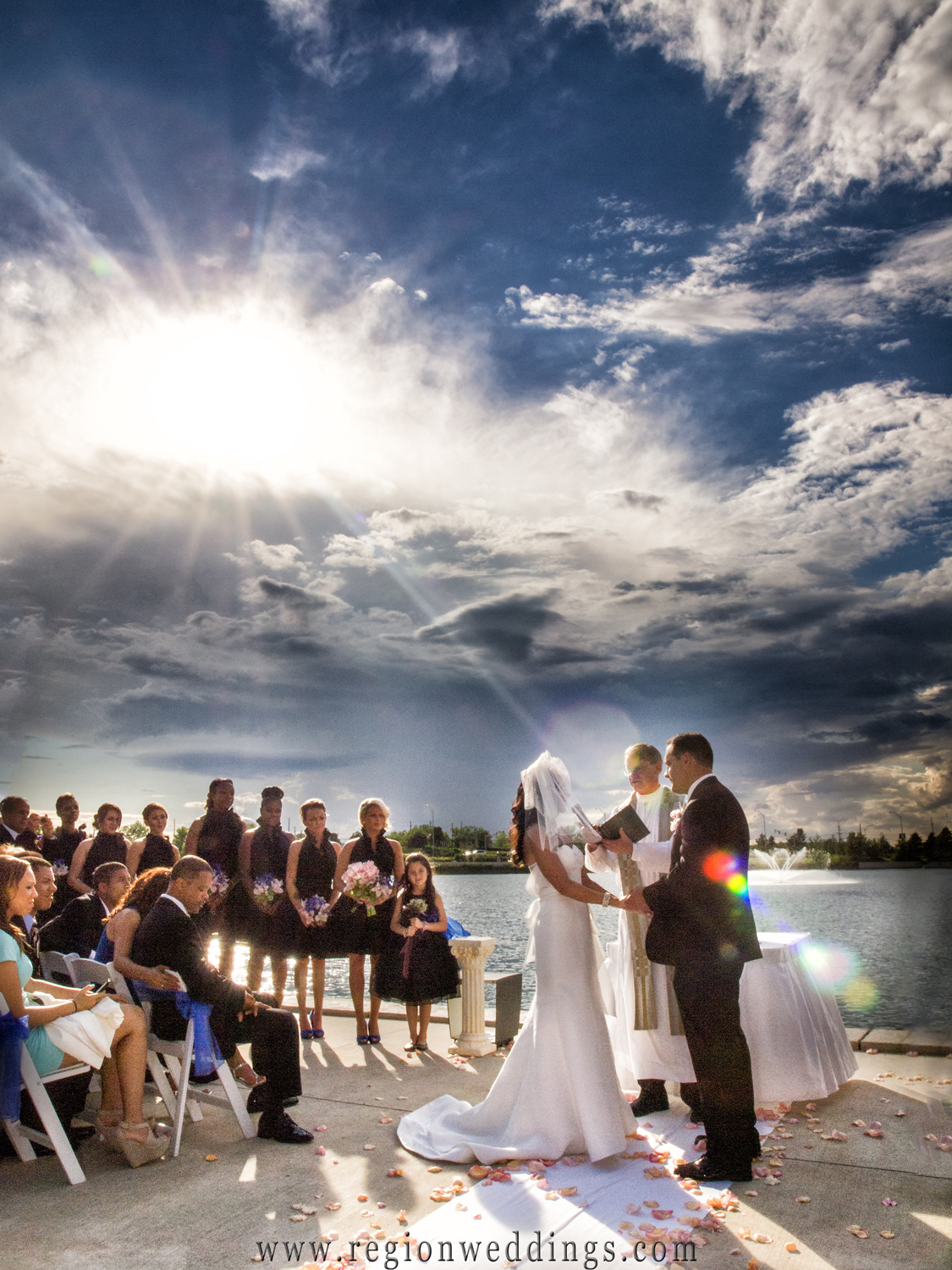 The sun shines down upon an outdoor wedding ceremony at Centennial Park in Munster, Indiana.