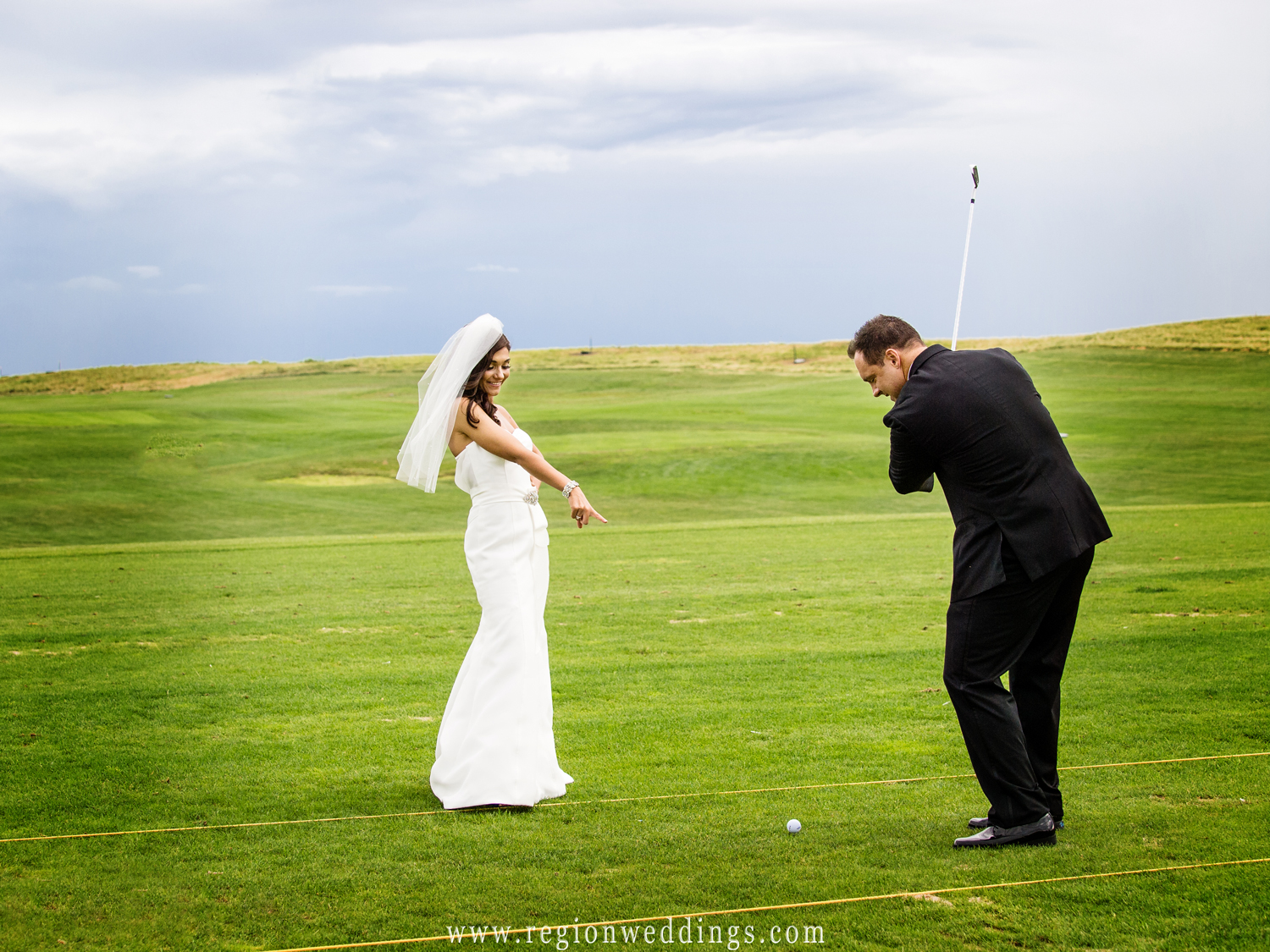 The bride and groom try out the golf driving range at Centennial Park.