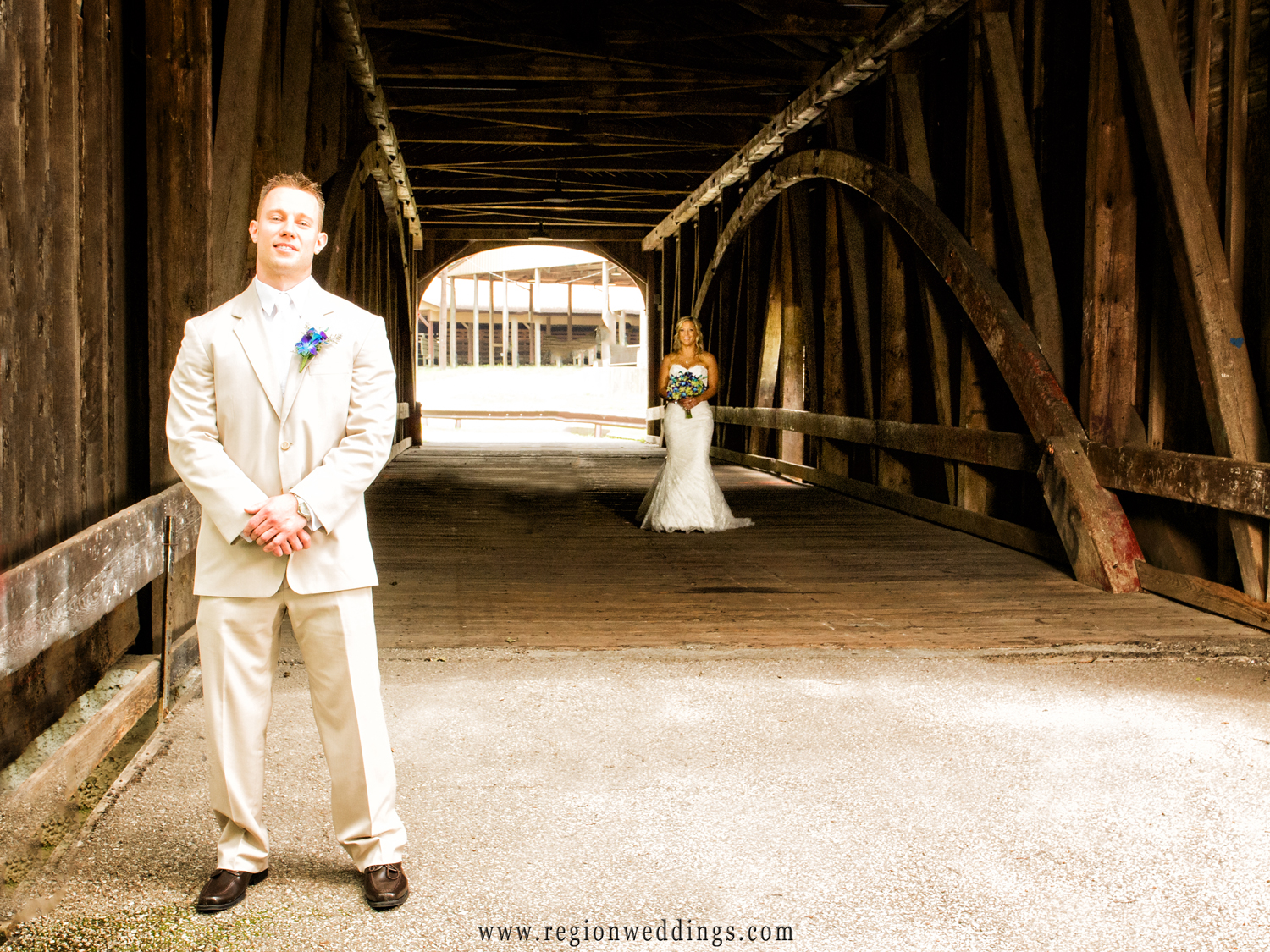 The bride and groom's first look at The Old Covered Bridge at the Lake County Fairgrounds in Crown Point, Indiana.
