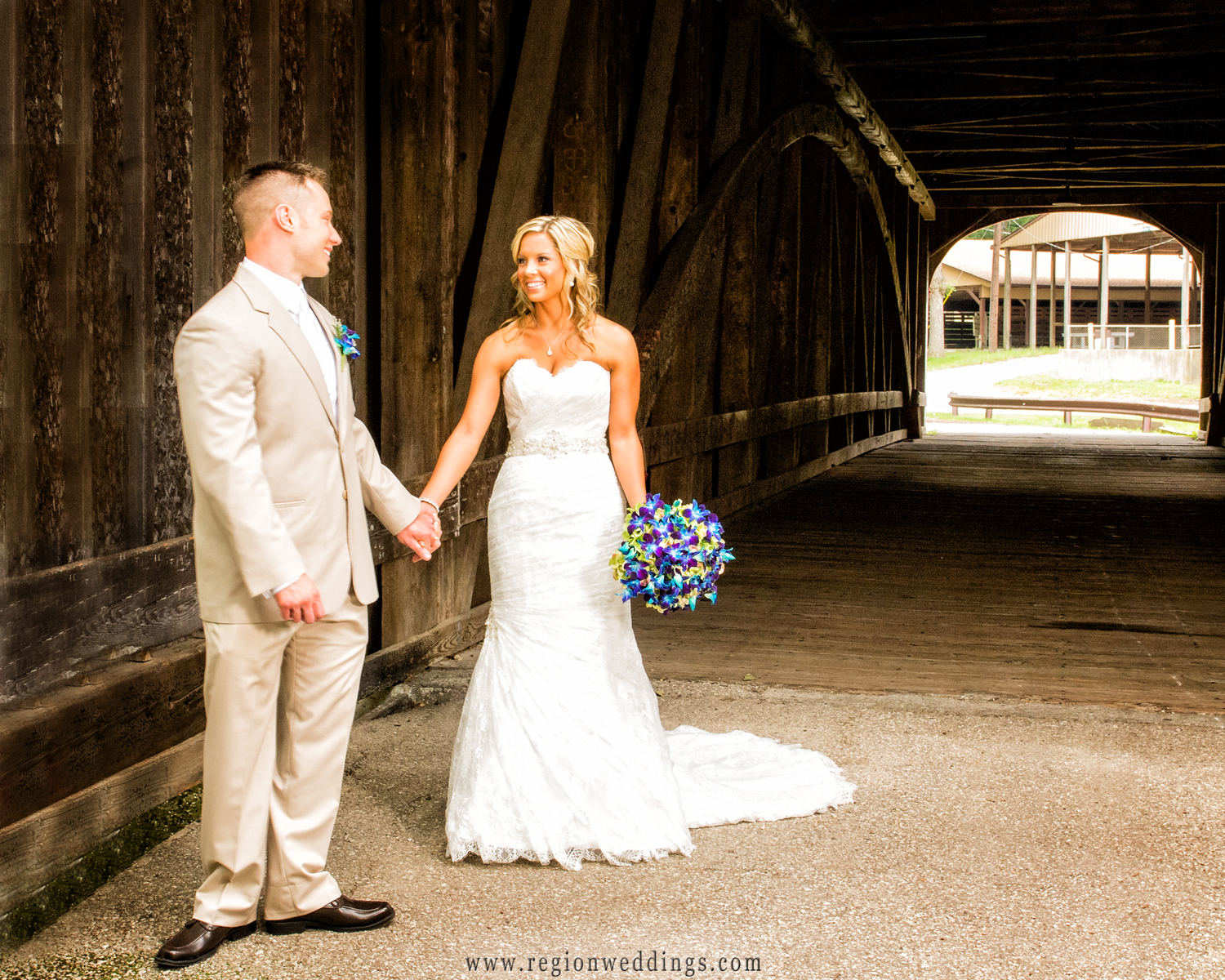 Bride and groom see each other for the first time at The Old Covered Bridge at the Lake County Fairgrounds in Crown Point, Indiana.