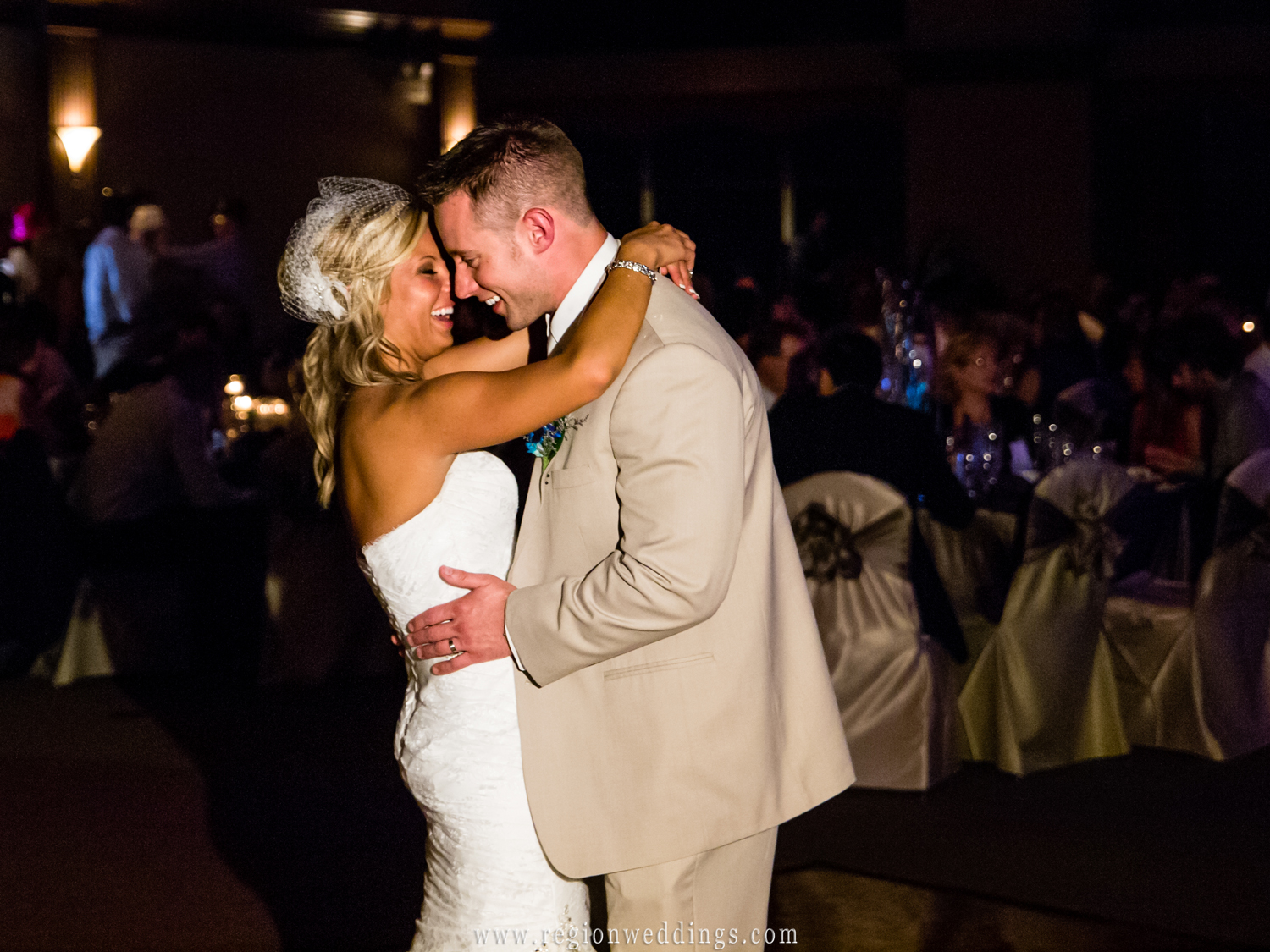 The bride and groom take their first dance at The Halls of St. George in Schererville, Indiana.