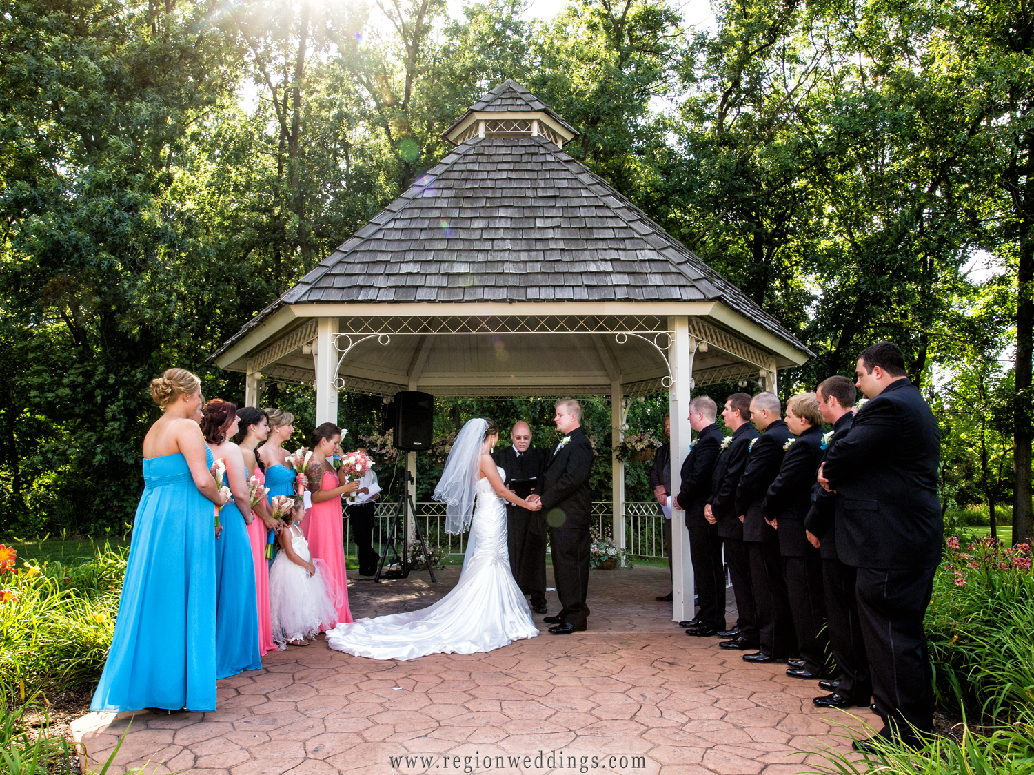 An outdoor summer wedding in the gazebo at the Halls of St. George in Schererville, Indiana.