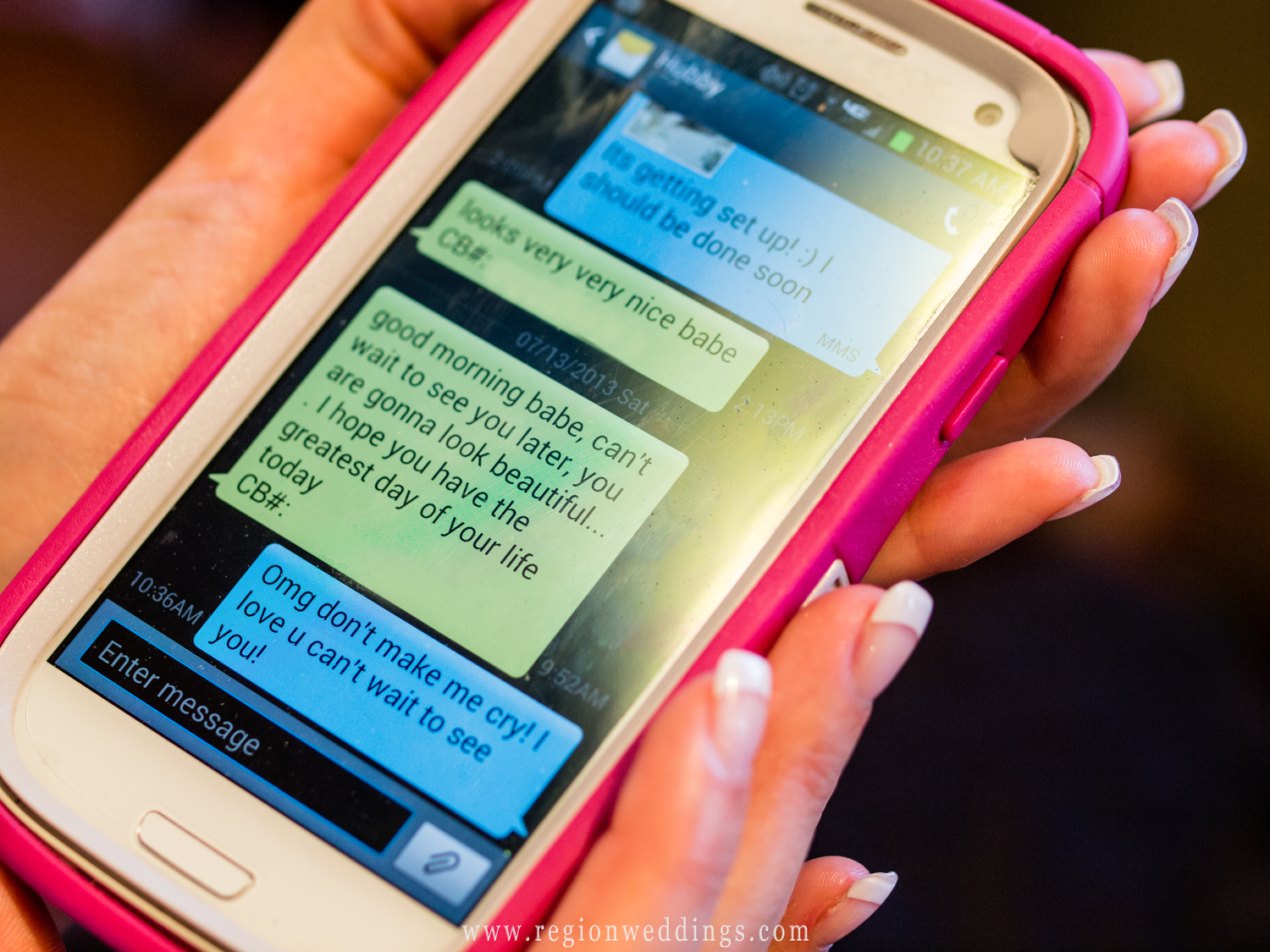 The bride and groom exchange text messages of love on their smartphones on the morning of their wedding.