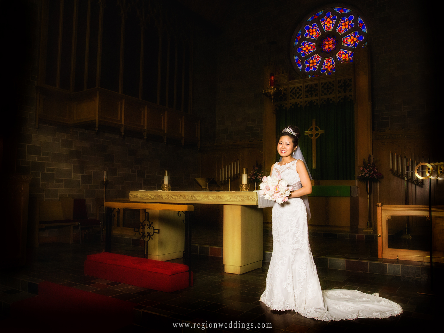 A Korean bride poses on the altar at Trinity Lutheran Church in Crown Point, Indiana.
