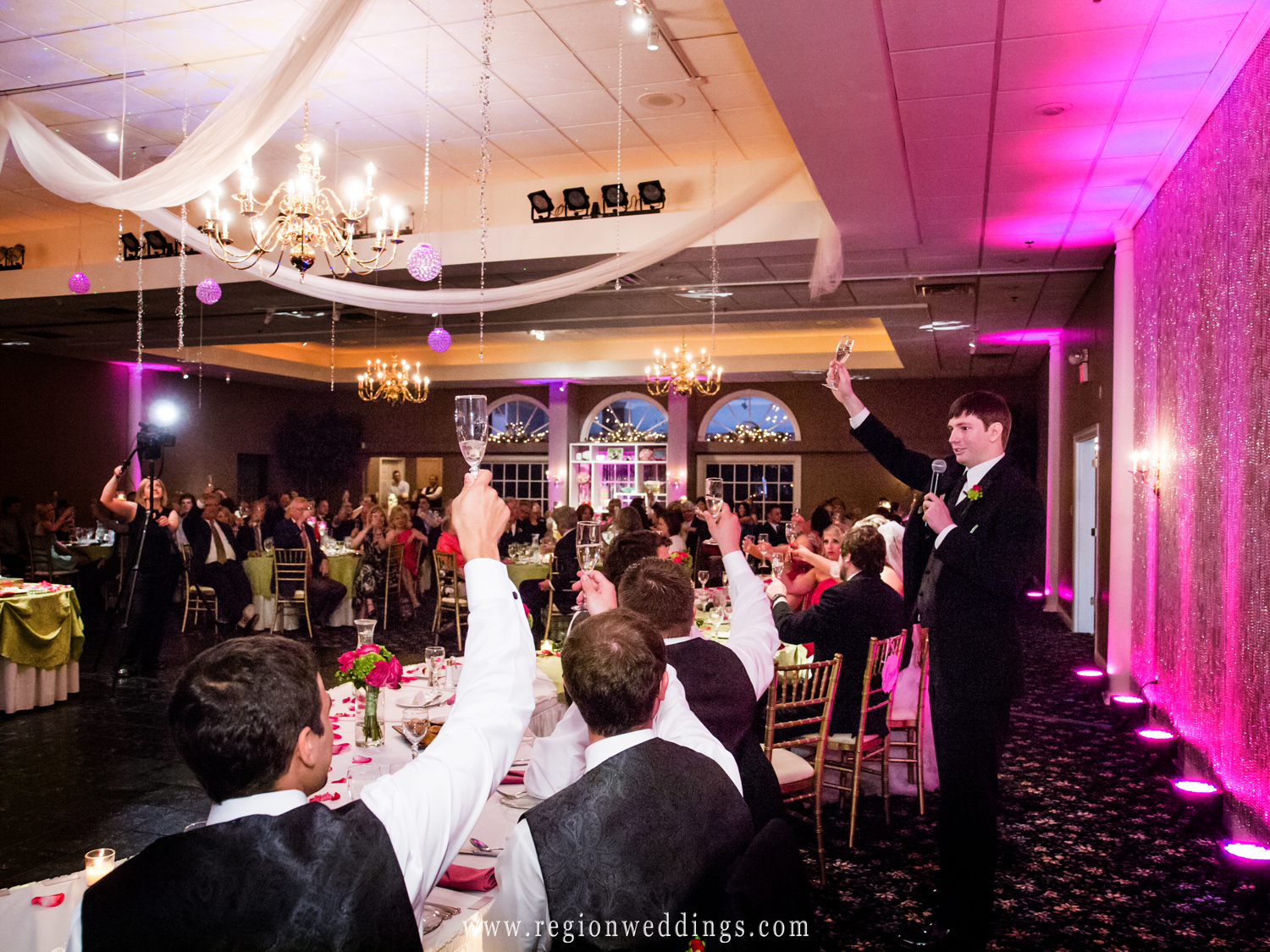 The best man raises his glass in tribute to the bride and groom.