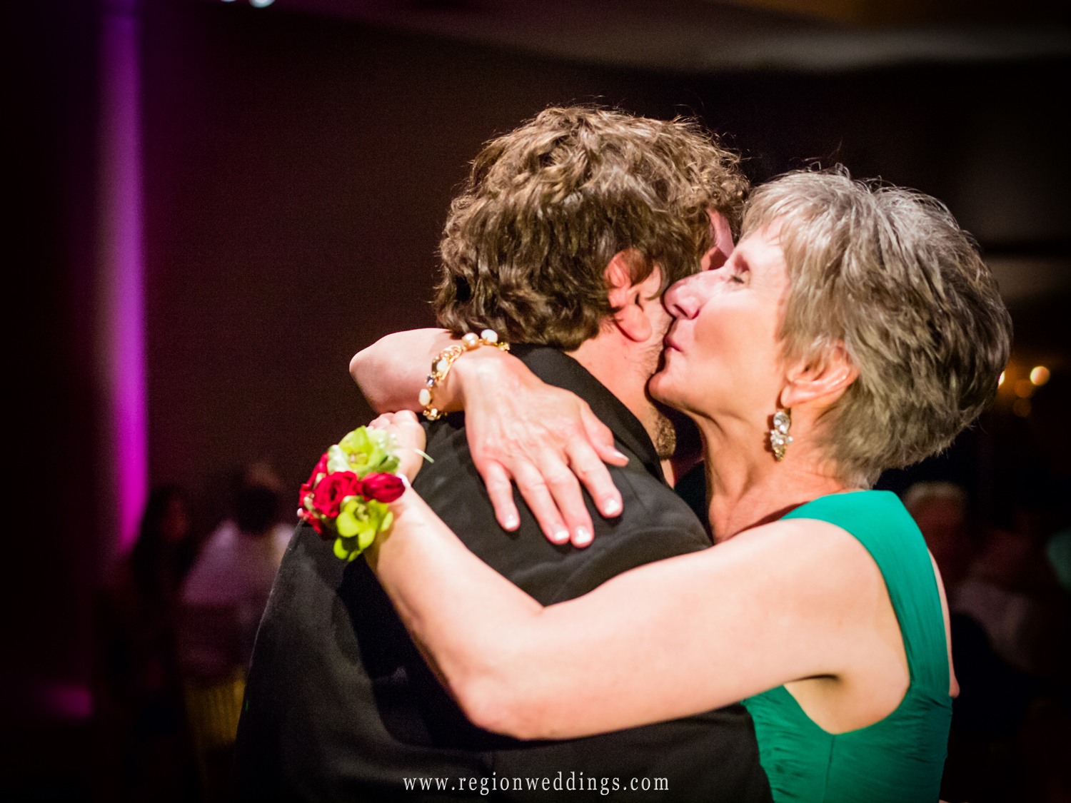 A tender moment on the dance floor between mother and son.