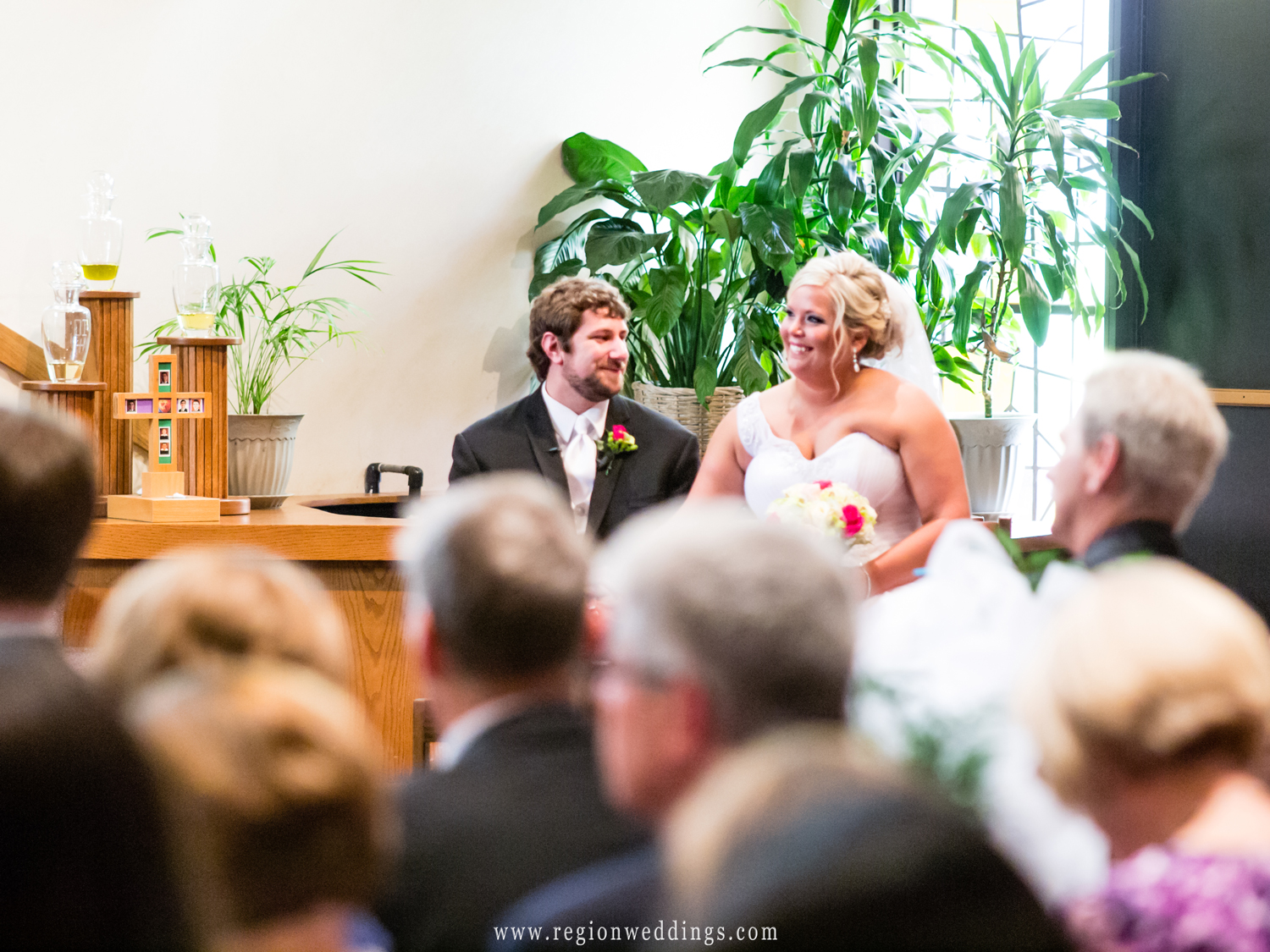 The bride and groom share a laugh during their wedding ceremony in Valparaiso.