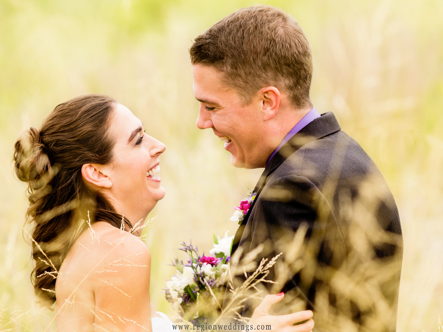 A newly married couple gazes at each other amongst the wildflowers of the Portage River Walk beach front.