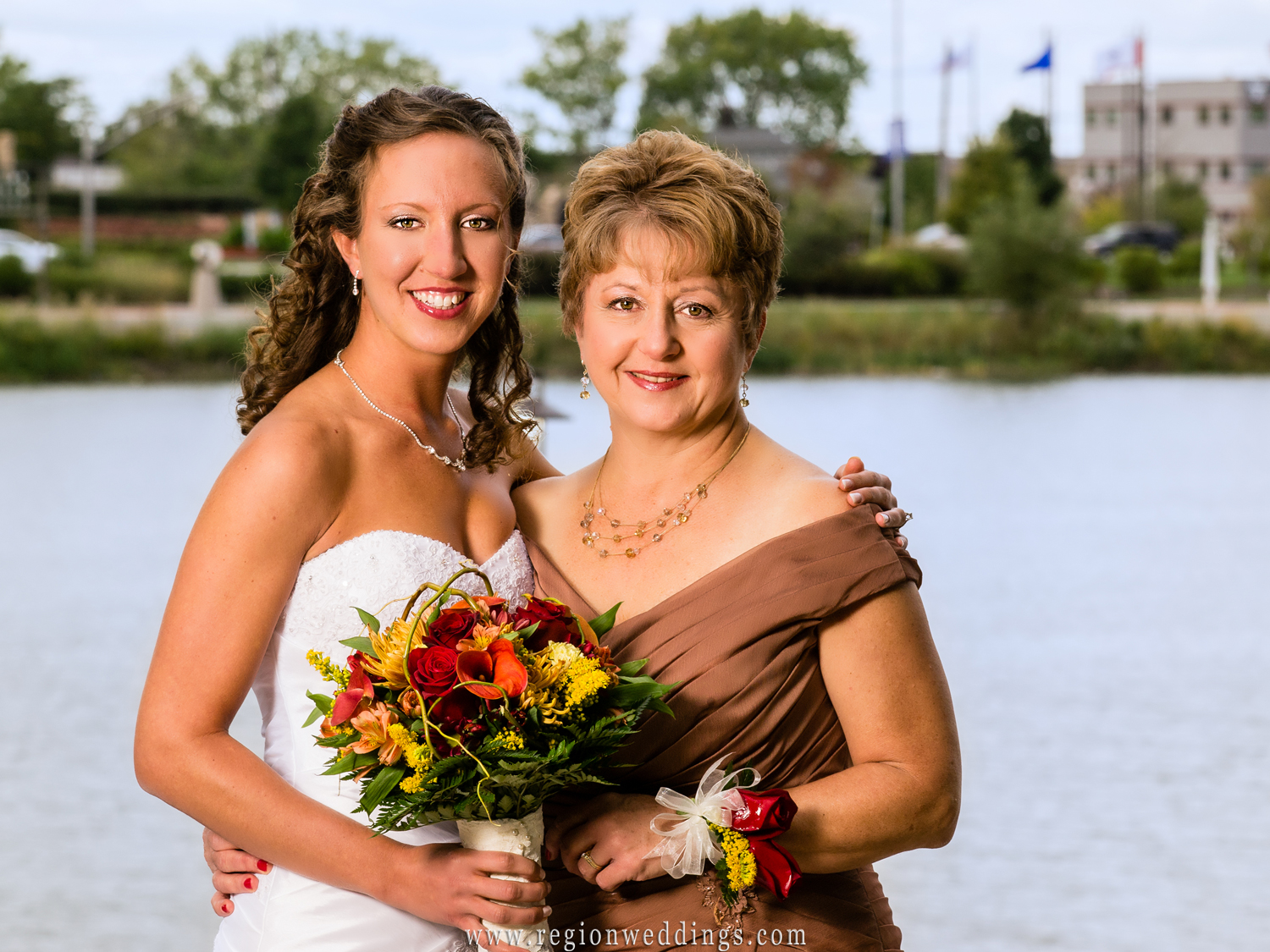 A bride and her mother on the outdoor terrace at Centennial Park.