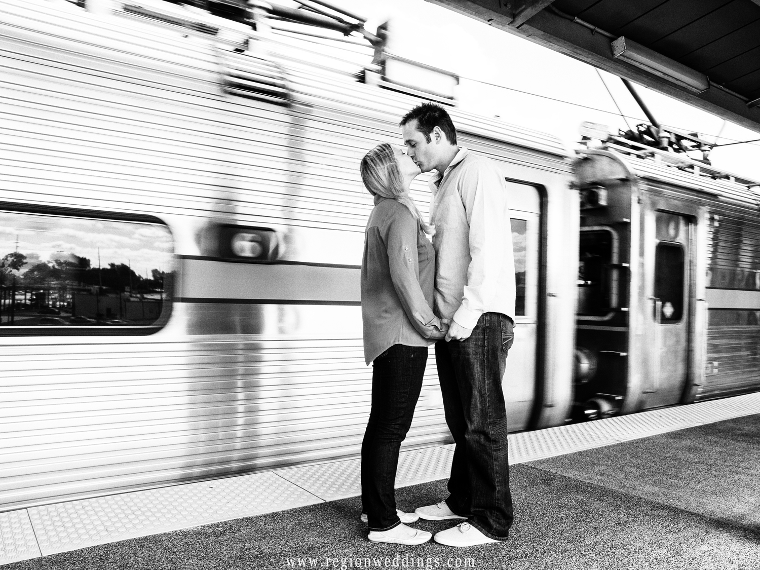 A couple in love huddle up on the train platform in East Chicago.