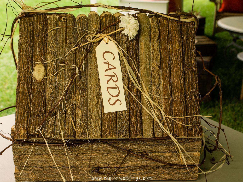 A homemade, rustic looking wedding gift card box.