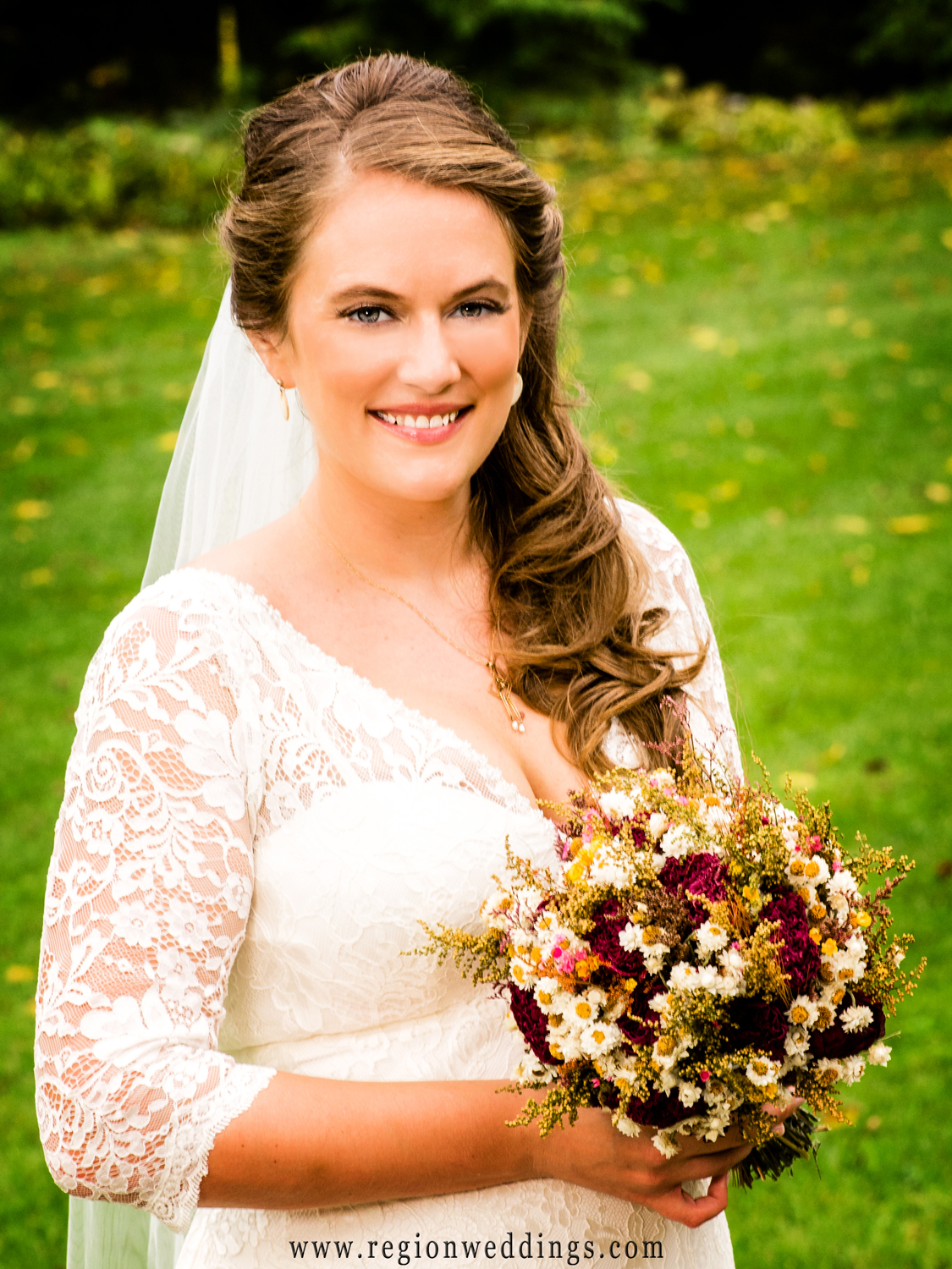 Beautiful bridal portrait taken in the Fall season with warm color.
