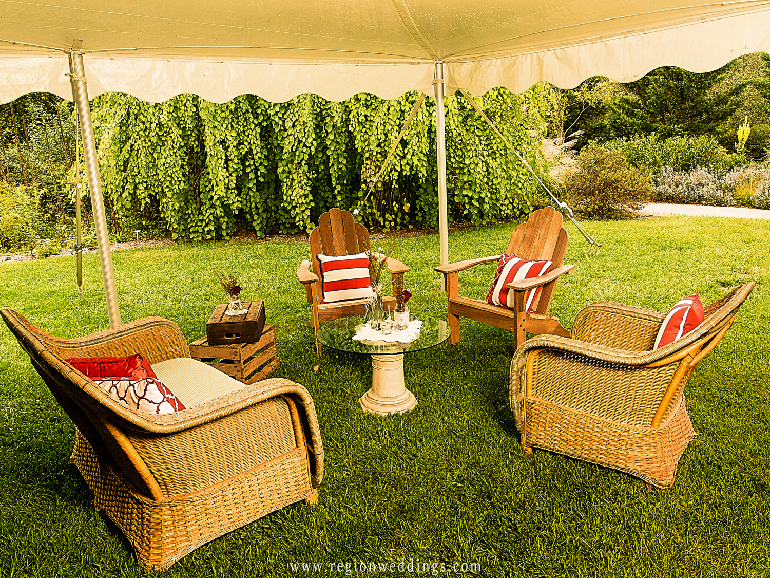 A lounge area at an outdoor wedding reception.