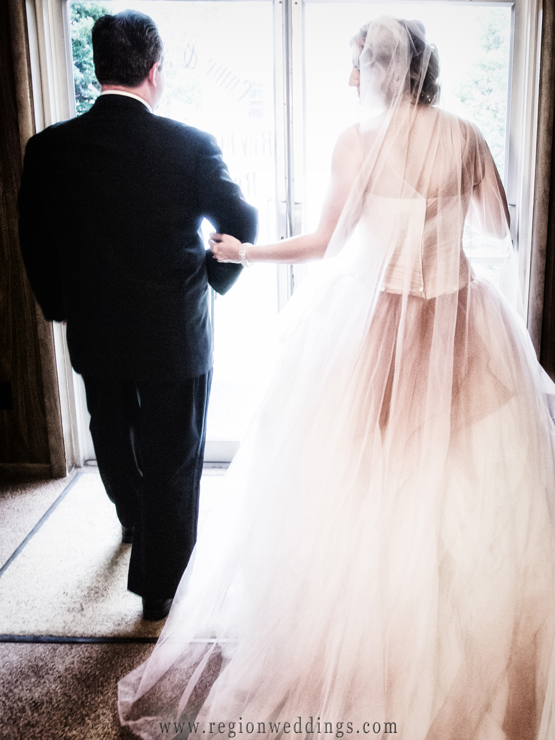 The bride and groom exit the Free Spirit Church with a glow of bright light upon them.